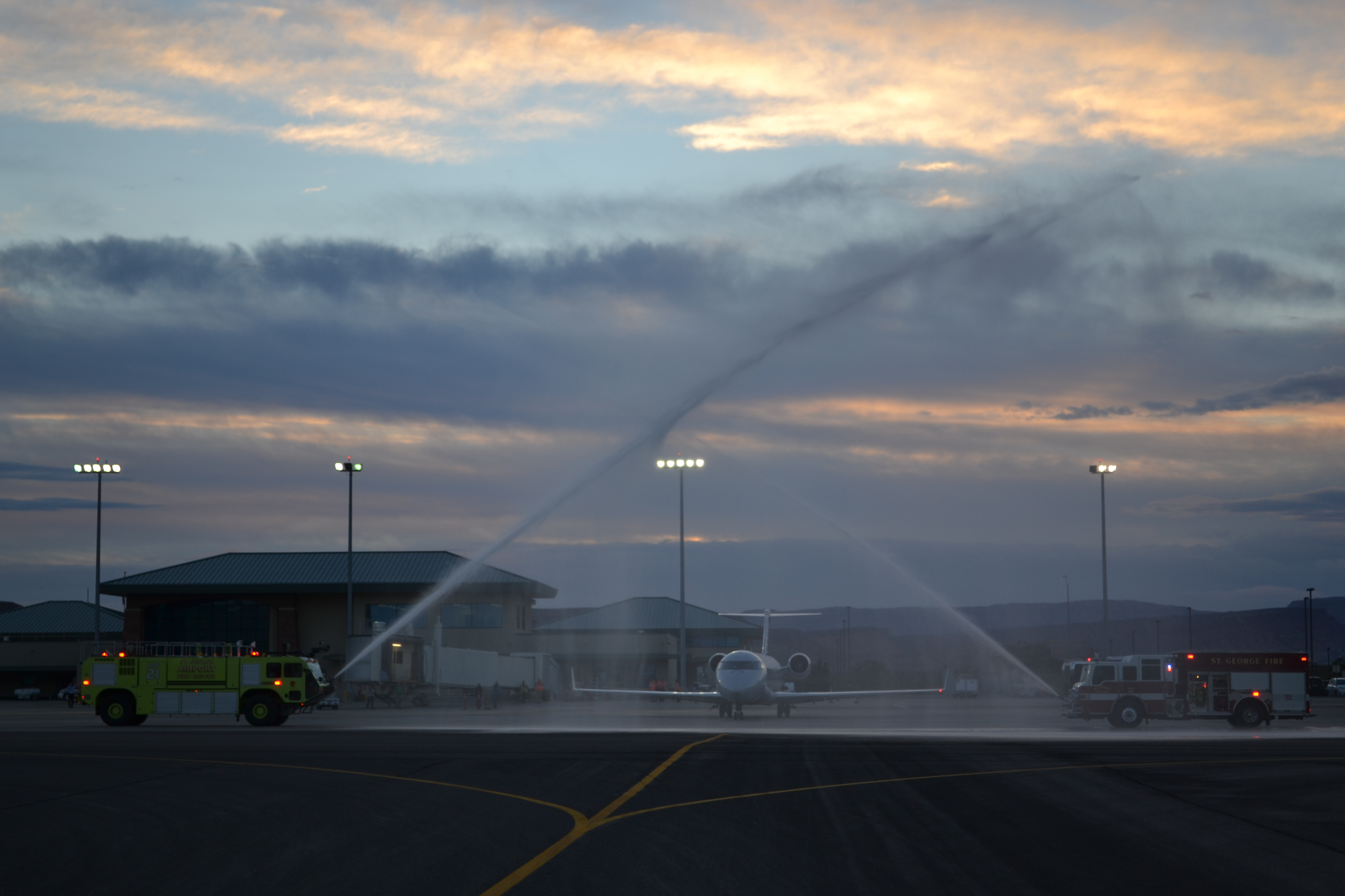 A Canadair Regional Jet is given a water cannon send-off by St. George Fire and St. George Airport engines before its inaugural flight to Phoenix, Arizona, St. George Regional Airport, Utah, Nov. 4, 2016 | Photo by Joseph Witham, St. George News