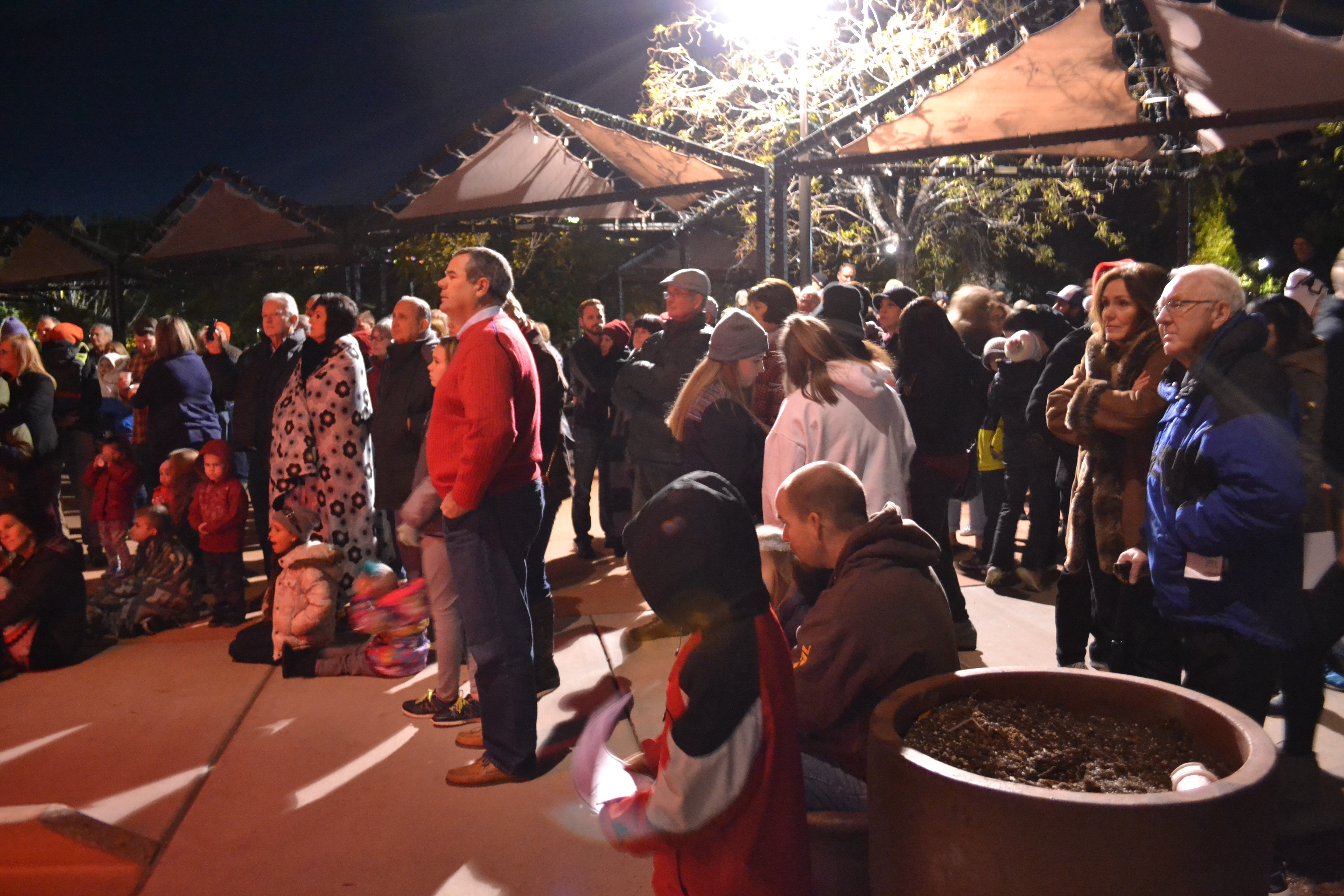 Guests watch performers sing at the St. George Town Square Christmas Lighting, St. George, Utah, Nov. 28, 2016 | Photo by Joseph Witham, St. George News