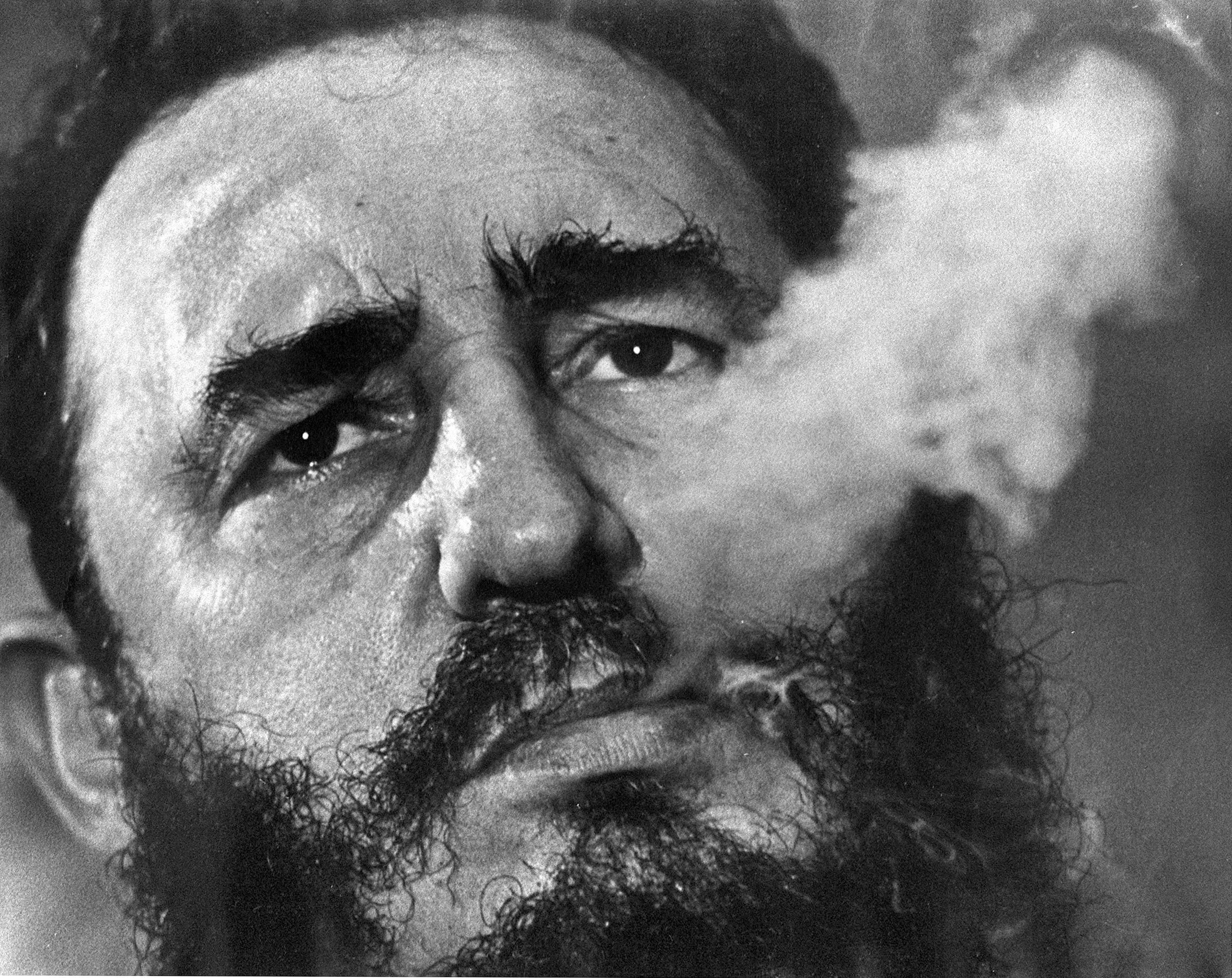 In this March 1985 AP file photo Cuba's leader Fidel Castro exhales cigar smoke during an interview at the presidential palace in Havana, Cuba.   AP file photo/Charles Tasnadi, St. George News