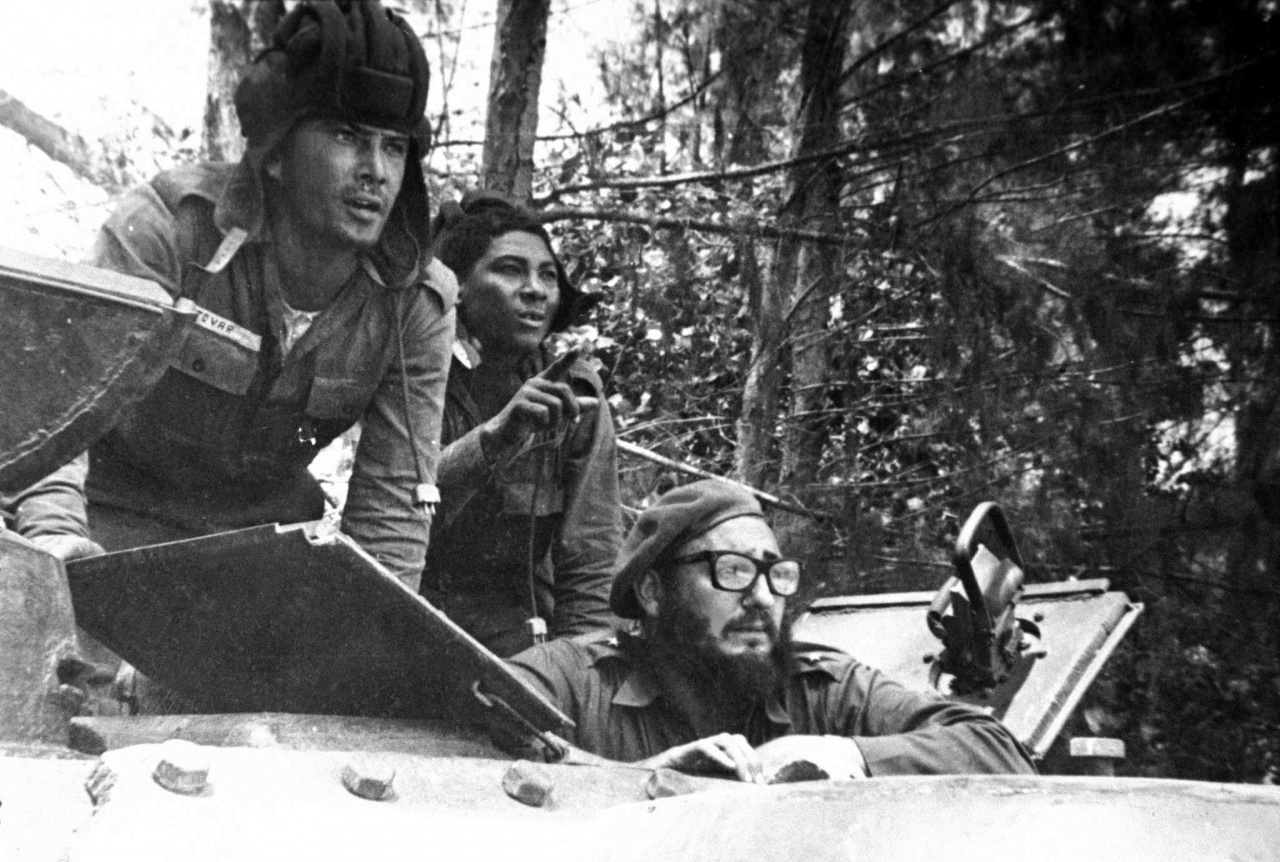 In this April 1961 file photo, Cuba's leader Fidel Castro, bottom, looks out from a tank during the Bay of Pigs invasion in Cuba. Former President Fidel Castro, who led a rebel army to improbable victory in Cuba, embraced Soviet-style communism and defied the power of 10 U.S. presidents during his half century rule, has died at age 90. The bearded revolutionary, who survived a crippling U.S. trade embargo as well as dozens, possibly hundreds, of assassination plots, died eight years after ill health forced him to formally hand power over to his younger brother Raul, who announced his death late Friday, Nov. 25, 2016, on state television. | AP Photo/Raul Corrales, The Canadian Press, File, St. George News