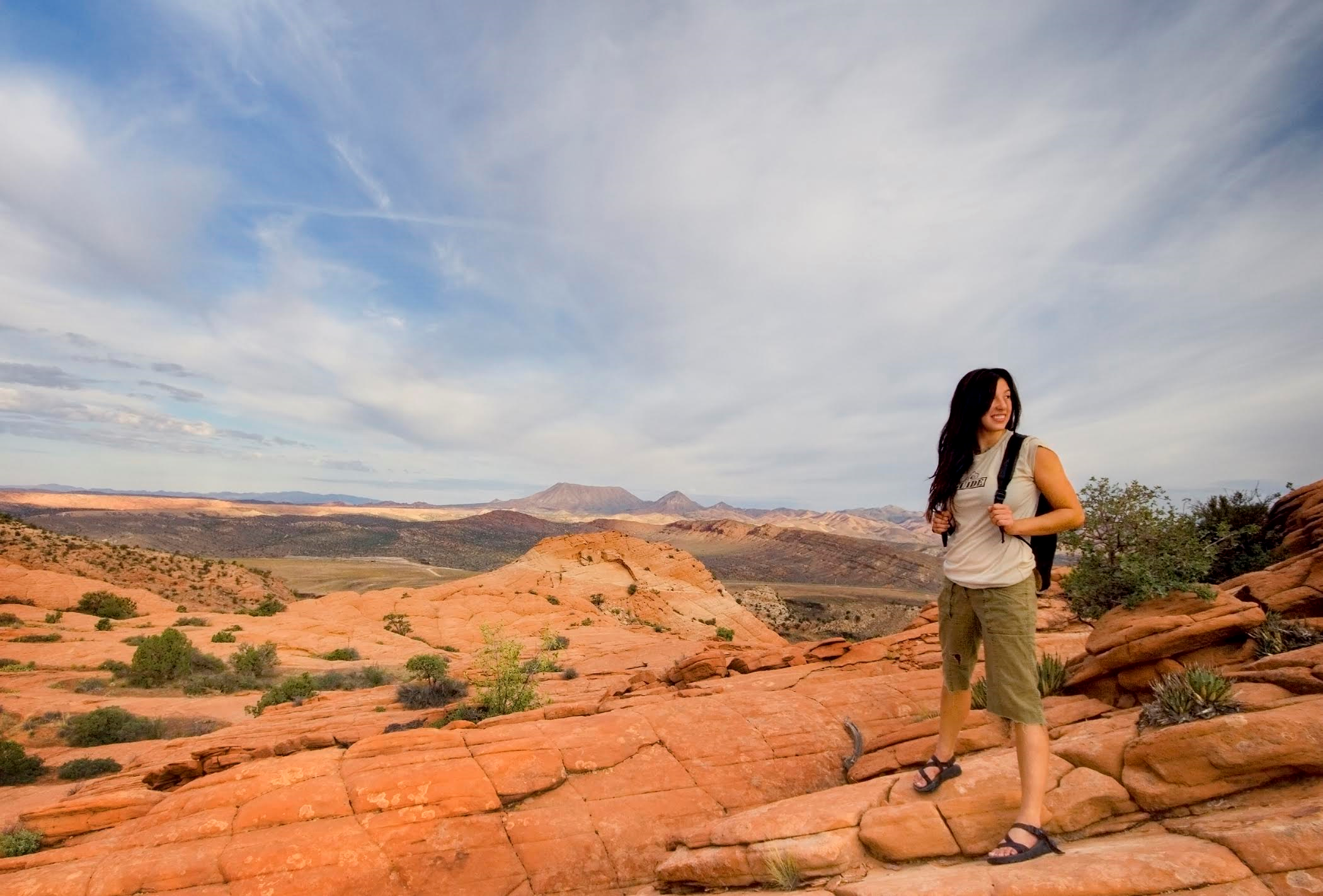 A hiking guide at Green Valley Spa pauses on the red rocks of Southern Utah during one of the spa's daily guided hikes, St. George, Utah, date not specified | Photo courtesy of Green Valley Spa, St. George/Cedar City News