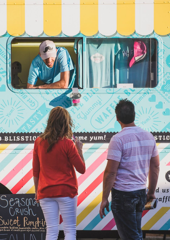 A couple orders from a food truck during George Streetfest, St. George, Utah, date not specified   Photo courtesy of Emceesquare Media Inc., St. George News