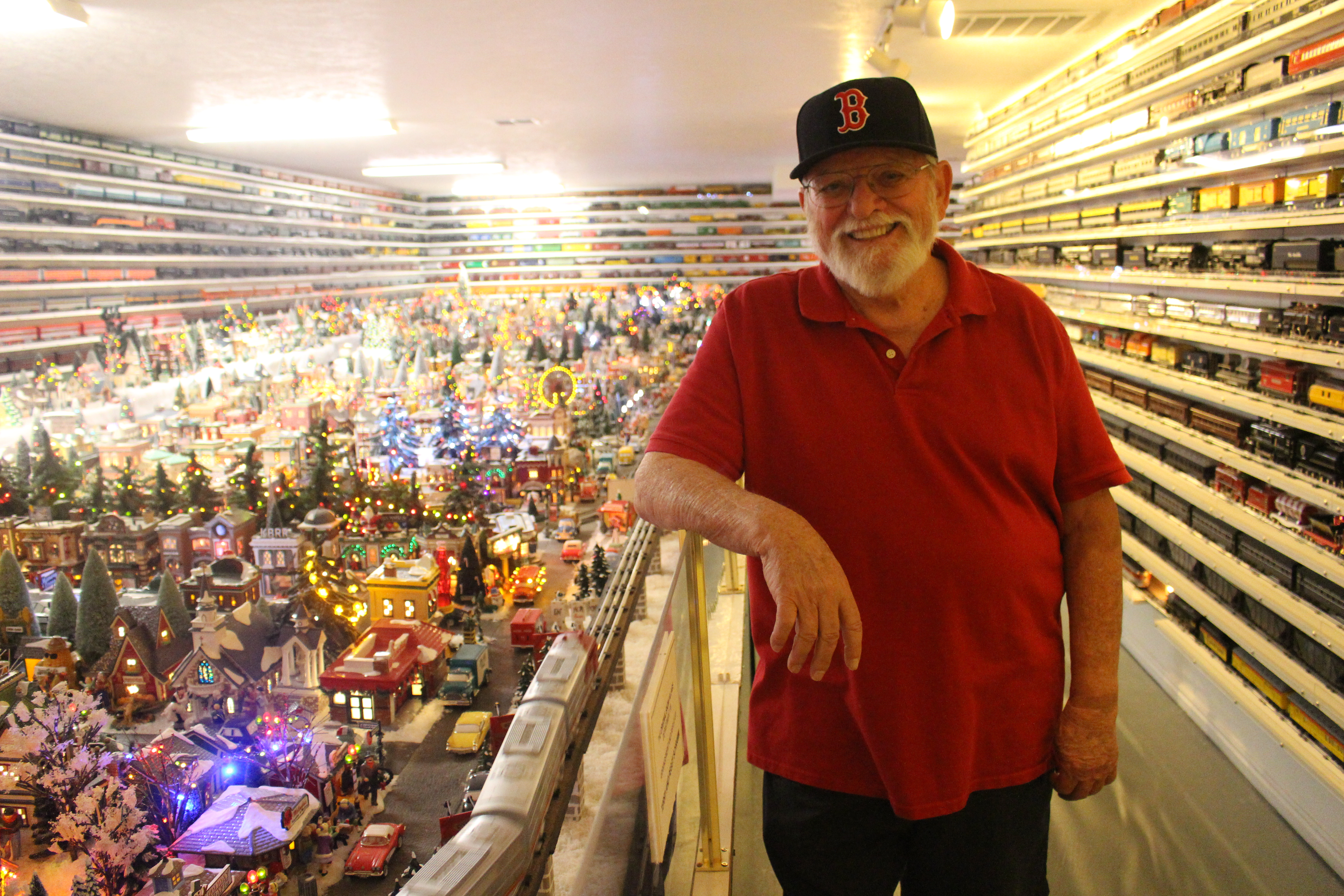 Terry Schramm poses next to his Lionel scale model railroad for the Color Country Model Railroad Tour at his home in St. George, Utah, Nov. 11, 2016 | Photo by Shelden Demke, St. George News