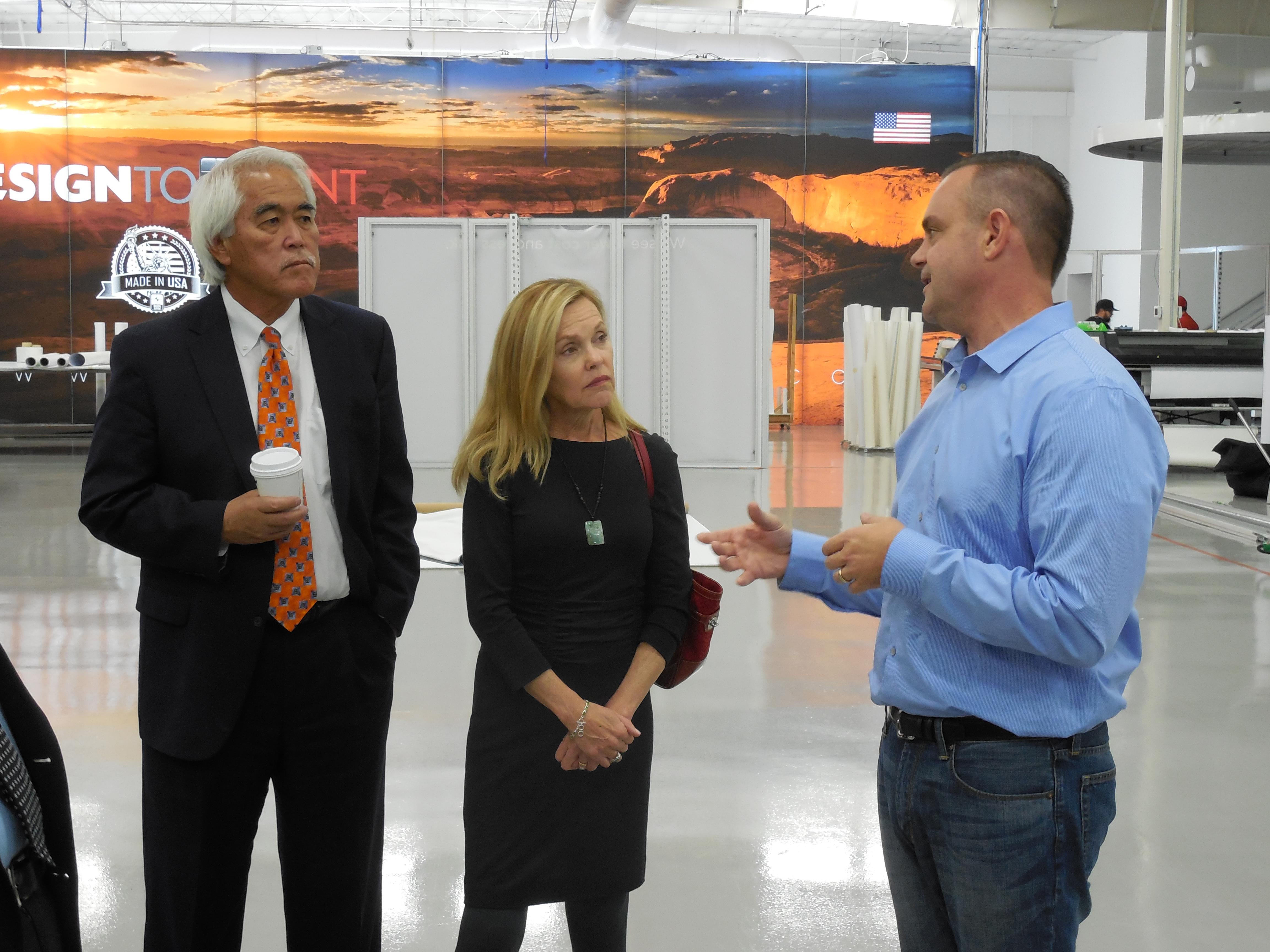 L-R, Stan Nakano, Betsy Markey and Josh Bevans. Bevans gives Markey and Nakano a tour of local business Design to Print, St. George, Utah, Nov. 17, 2016 | Photo by Julie Applegate, St. George News