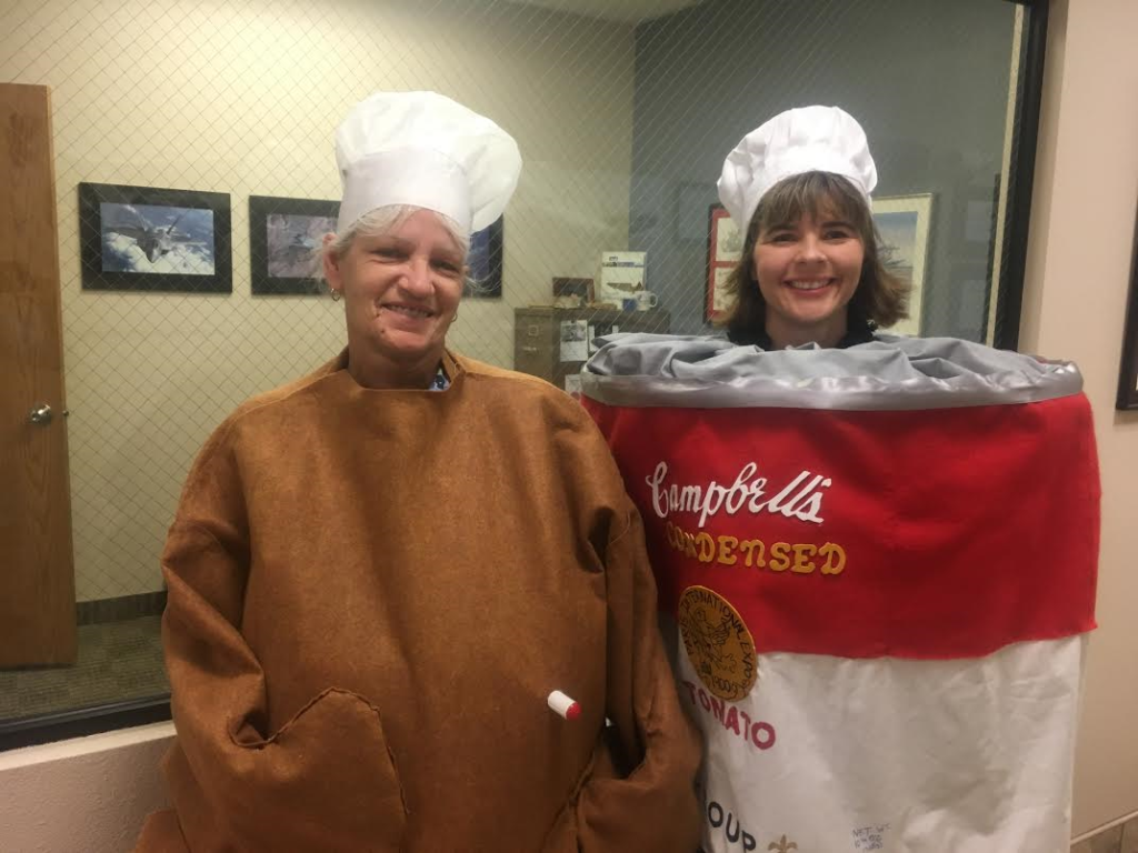L-R: Linda Wallace (Team Blue) and Brandy Adams (Team Red) show off their costumes for the RAM Company's employee food drive, St. George, Utah, Nov. 20, 2016 | Photo by Hollie Reina, St. George News