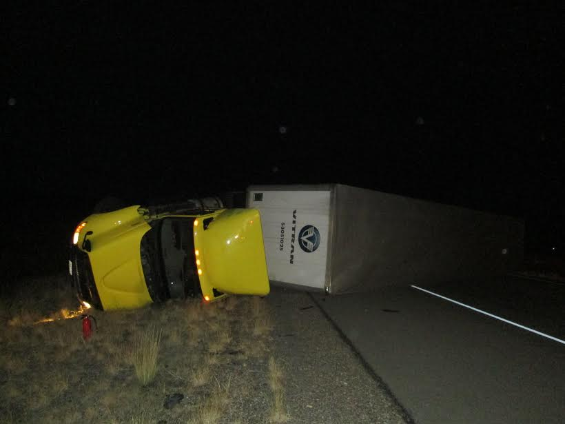 Both Interstate 15 northbound lanes of travel were closed after a semitractor-trailer hauling corrosive hazardous material rolled at milepost 203, Scipio, Utah, Nov. 23, 2016 | Photo courtesy of Utah Highway Patrol, St. George News