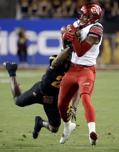 Utah wide receiver Raelon Singleton pulls in a touchdown pass as Arizona State defensive back Chad Adams (21) defends during the first half of an NCAA college football game, Thursday, Nov. 10, 2016, in Tempe, Ariz. (AP Photo/Matt York)