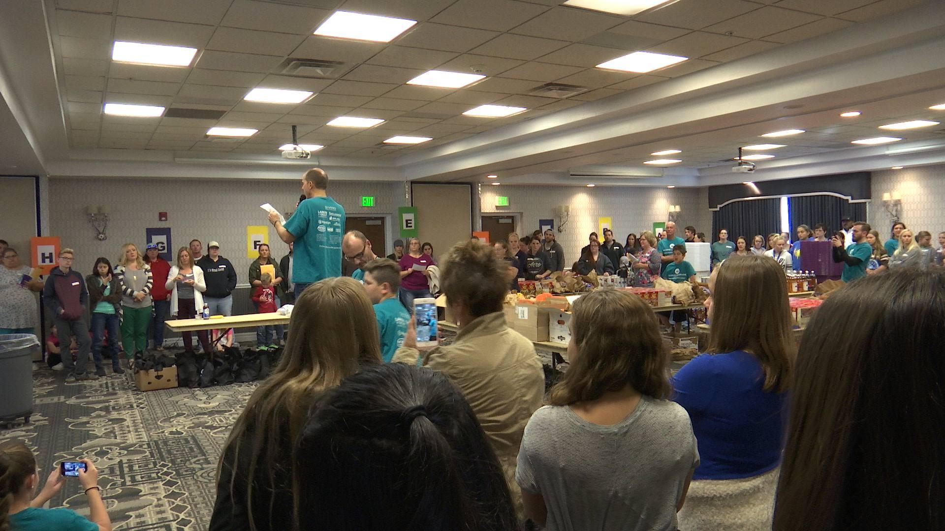 Basket Brigade organizer Jeremy Larkin, standing in blue shirt, addresses volunteers before the Basket Brigade starts assembling food baskets. St. George, Utah, Nov. 19, 2016 | Photo by Sheldon Demke, St. George News