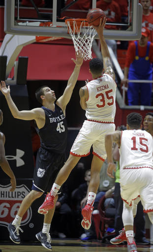 Utah forward Kyle Kuzma (35) shoots as Butler forward Andrew Chrabascz (45) defends in the first half during an NCAA college basketball game Monday, Nov. 28, 2016, in Salt Lake City. (AP Photo/Rick Bowmer)