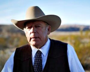 Rancher Cliven Bundy stands along the road near his ranch after speaking with media. Cliven Bundy and his wife Carol Bundy were returning from a trip to visit the family of LaVoy Finicum, a 55-year-old rancher from Cain Beds, Ariz., who died Tuesday after law enforcement officers initiated a traffic stop near the Malheur National Wildlife Refuge. It's unclear what happened in the moments before his death. Bunkerville, Nevada, Jan. 27, 2016 | AP Photo by John Locher, St. George News