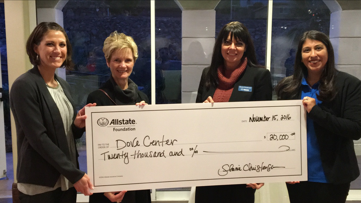 L to R: Lindsay Boyer, Cindy Richardson, Shonie Christensen and Marlene DeMotte holding $20,000 check representing grant awarded to the Dove Center by the Allstate Foundation at The Falls Event Center Tuesday, St. George, Utah, Nov. 15, 2016 | Photo courtesy of Shonie Christrensen, St. George News
