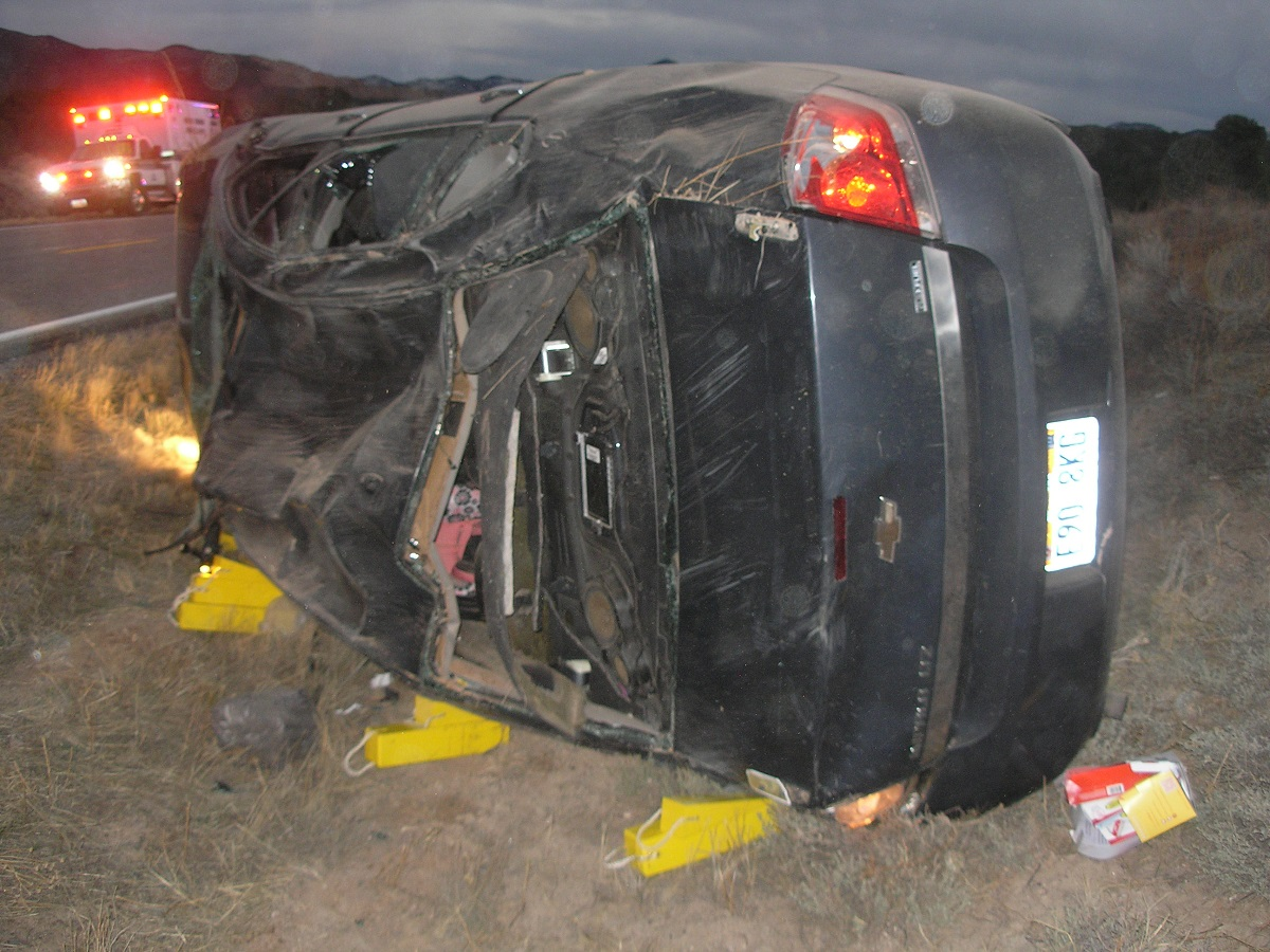Dark Chevrolet Impala that was involved in a rollover on SR-56 that involved the driver and two three-month-old infants, one of which was transported by air to Primary Children's Hospital, Iron County, Utah, Nov. 30, 2016 | Photo courtesy of the Utah Highway Patrol, St. George News