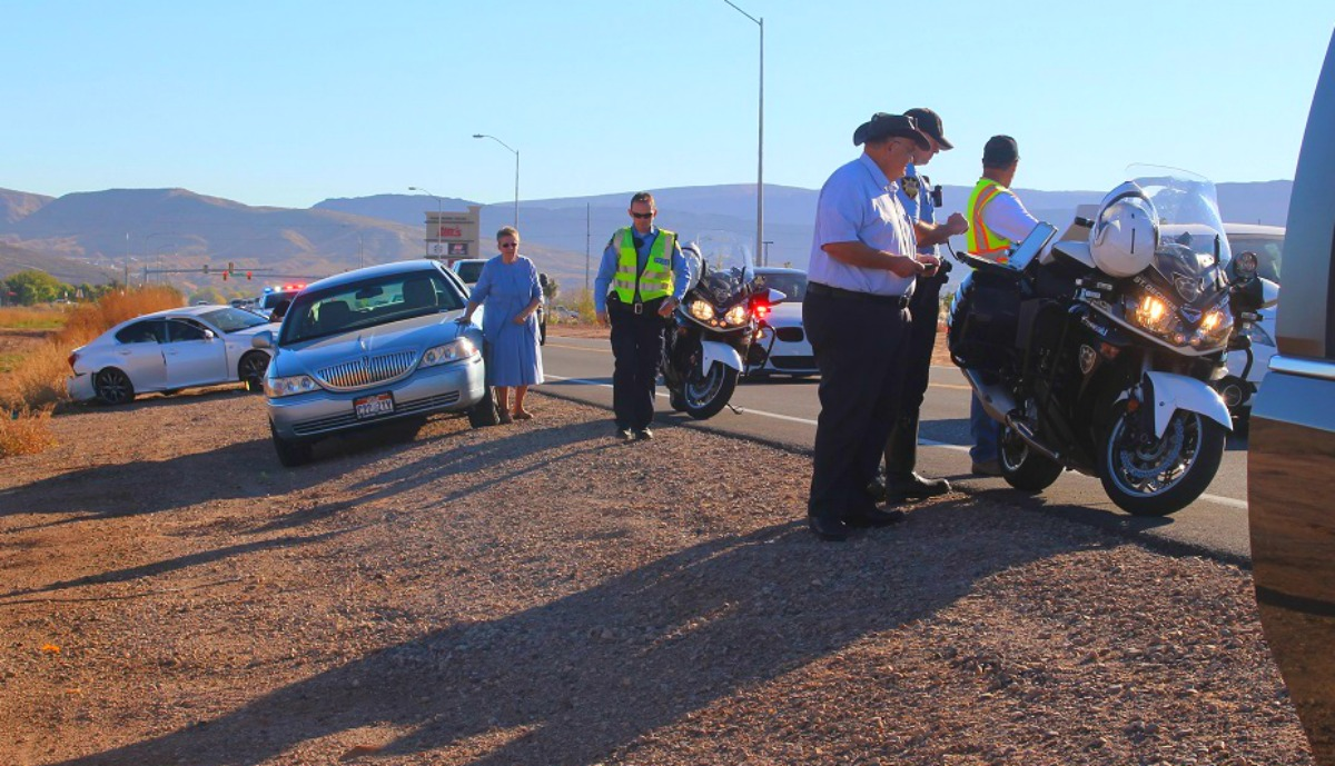 Blue Lincoln Towncar in the background at three-car collision on S. Mall Drive that was set off by a distracted driver Thursday, St. George, Utah, Nov. 10, 2016 | Photo by Cody Blowers, St. George News