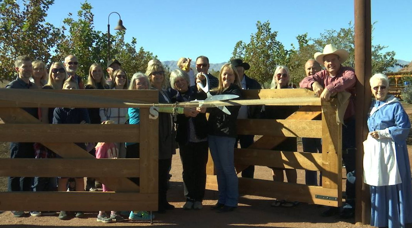 City officials and members of the Seegmiller family about to cut the ribbon signifying the completion and official opening of the Hela Seegmiller Historic Farm in Little Valley, St. George, Utah, Nov. 18, 2016 | Photo by Sheldon Demke, St. George News