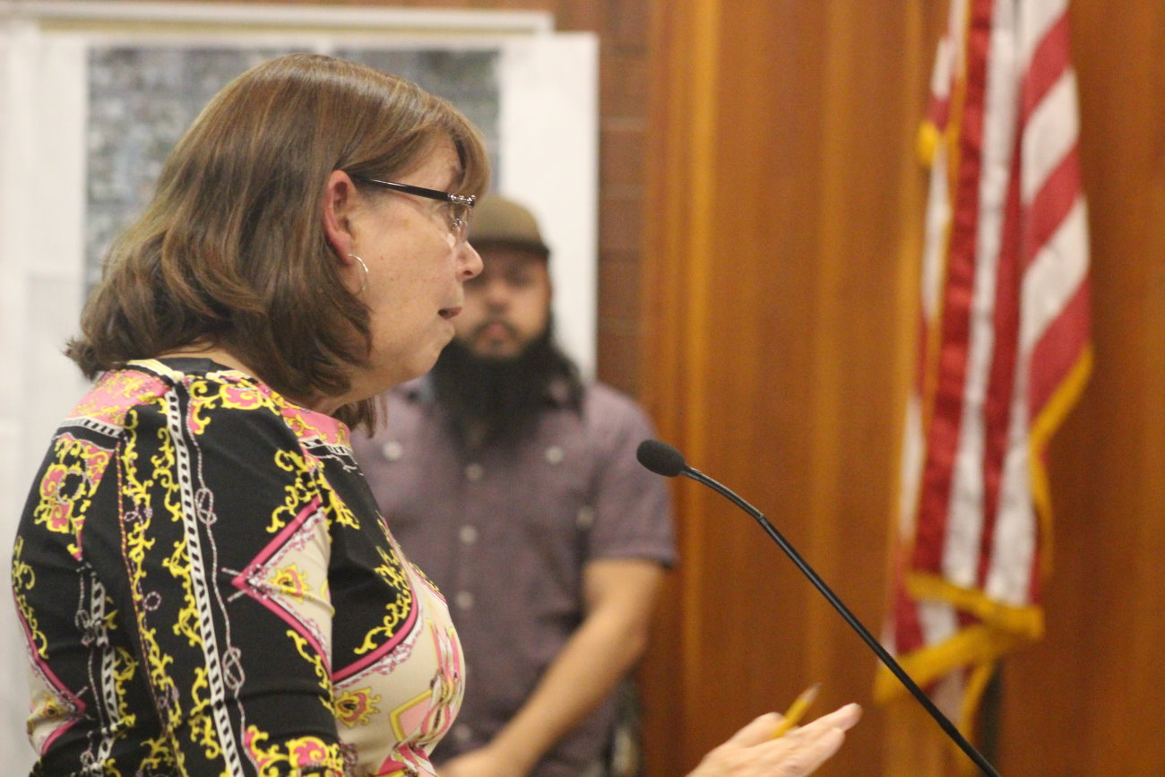 Riverstone resident Judy Harlin speaks to the City Council about concerns that the aesthetics of the southern entry into St. George via I-15 may be ruined by potentially allowing auto sales in the area around the Exit 2/Atkinville interchange, St. George, Utah, Oct. 3, 2016 | Photo by Mori Kessler, St. George News