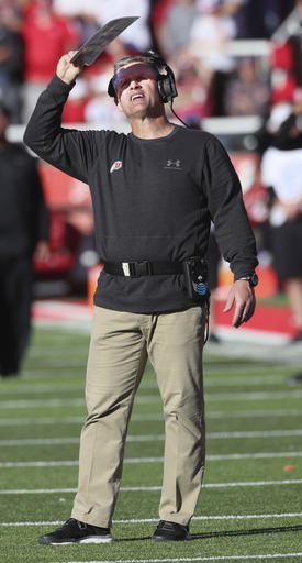 Utah head coach Kyle Whittingham, looks at an instant replay on the scoreboard in the second half during an NCAA college football game, Saturday, Nov. 19, 2016, in Salt Lake City. Oregon defeated Utah 30-28. (AP Photo/George Frey)