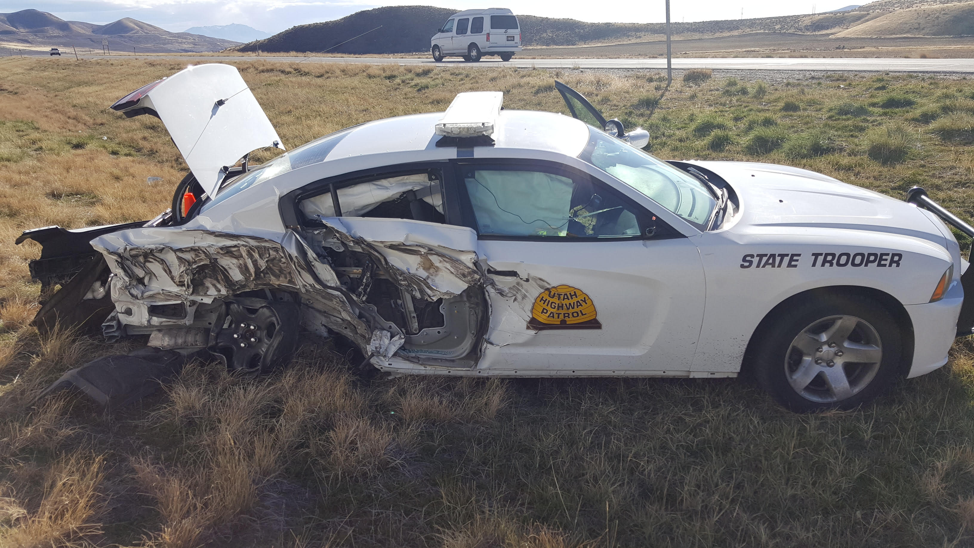 While providing traffic control for a vehicle fire, a UHP trooper's patrol car is struck by a semi on Interstate 84 near milepost 34, Box Elder County, Utah, Nov. 21, 2016   Photo courtesy of the Utah Highway Patrol, St. George News