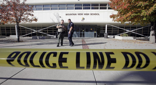 Police stand outside Mountain View High School after several students were stabbed inside the high school Tuesday, Nov. 15, 2016, in Orem, Utah Police say a 16-year-old boy was taken into custody after the stabbings. (AP Photo/Rick Bowmer)