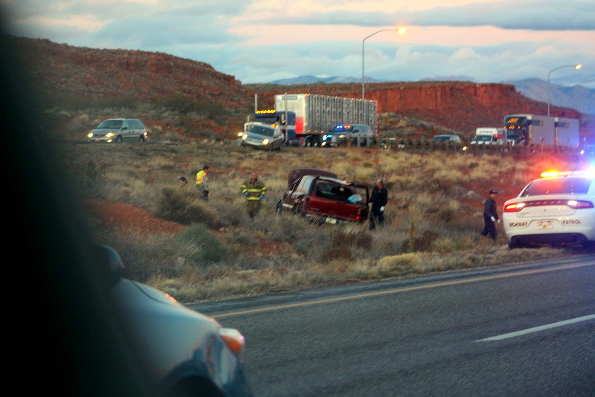 The Red GMC yukon after the rollover on Interstate 15 that resulted in an injured driver Sunday evening, Washington County, Utah, Nov. 27, 2016 | Photo by Cody Blowers, St. George News
