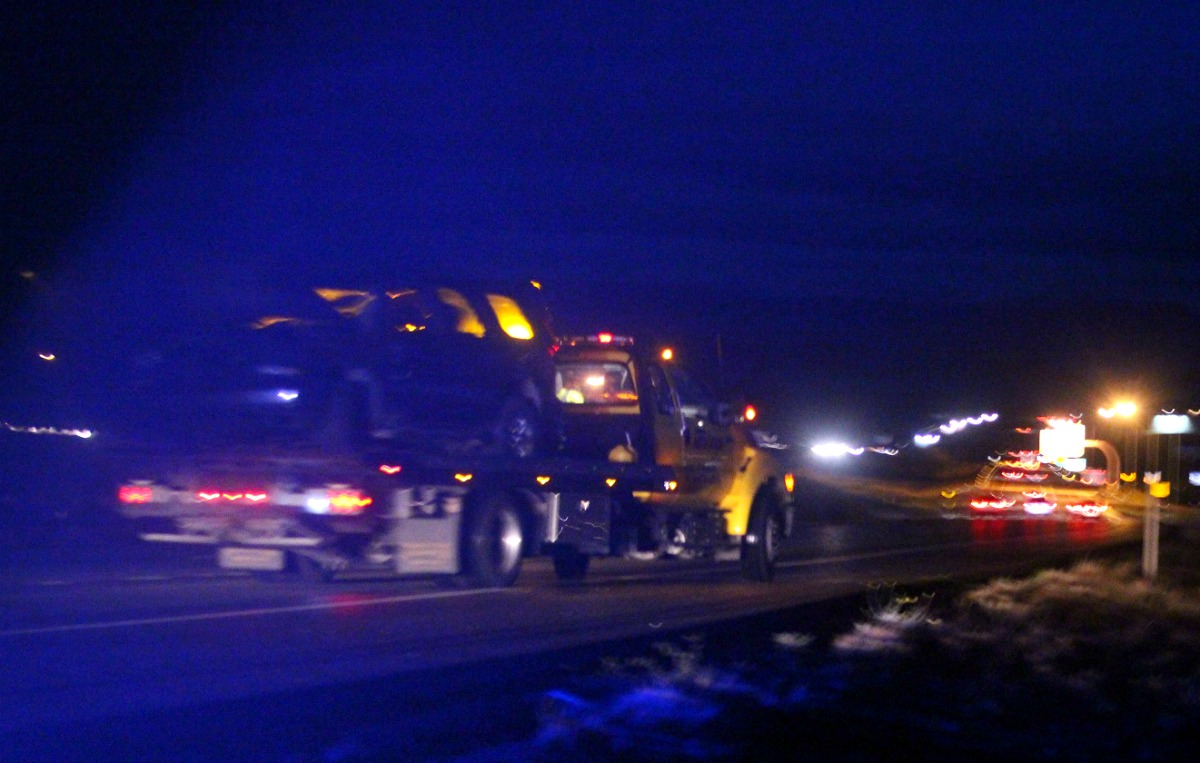 Red GMC Yukon was towed from the median after a rollover on Interstate 15 resulted in an injuried driver who was transported by ambulance Sunday evening, Washington County, Utah, Nov. 27, 2016 | Photo by Cody Blowers, St. George News