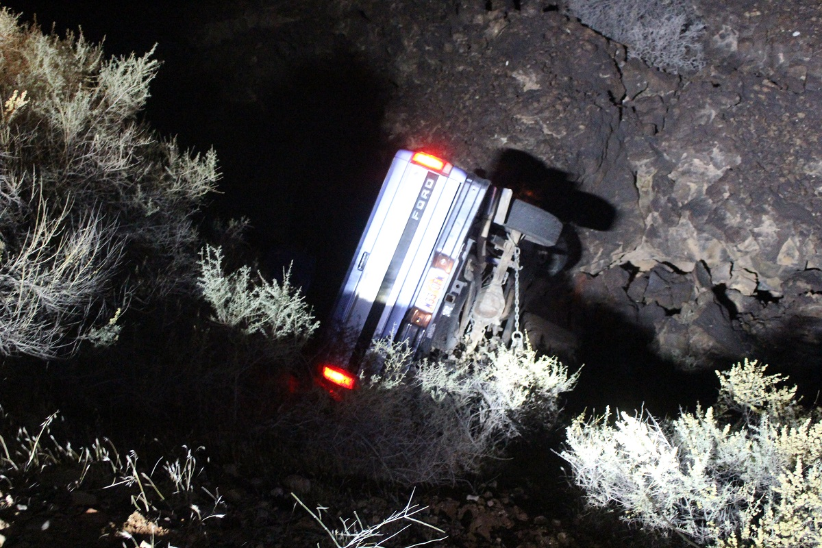 Blue Ford pickup came to rest down deep ravine after driver fell asleep and left the roadway early Friday Morning, W. Pioneer Road, Santa Clara, Utah, November 25, 2016 | Photo by Cody Blowers, St. George News