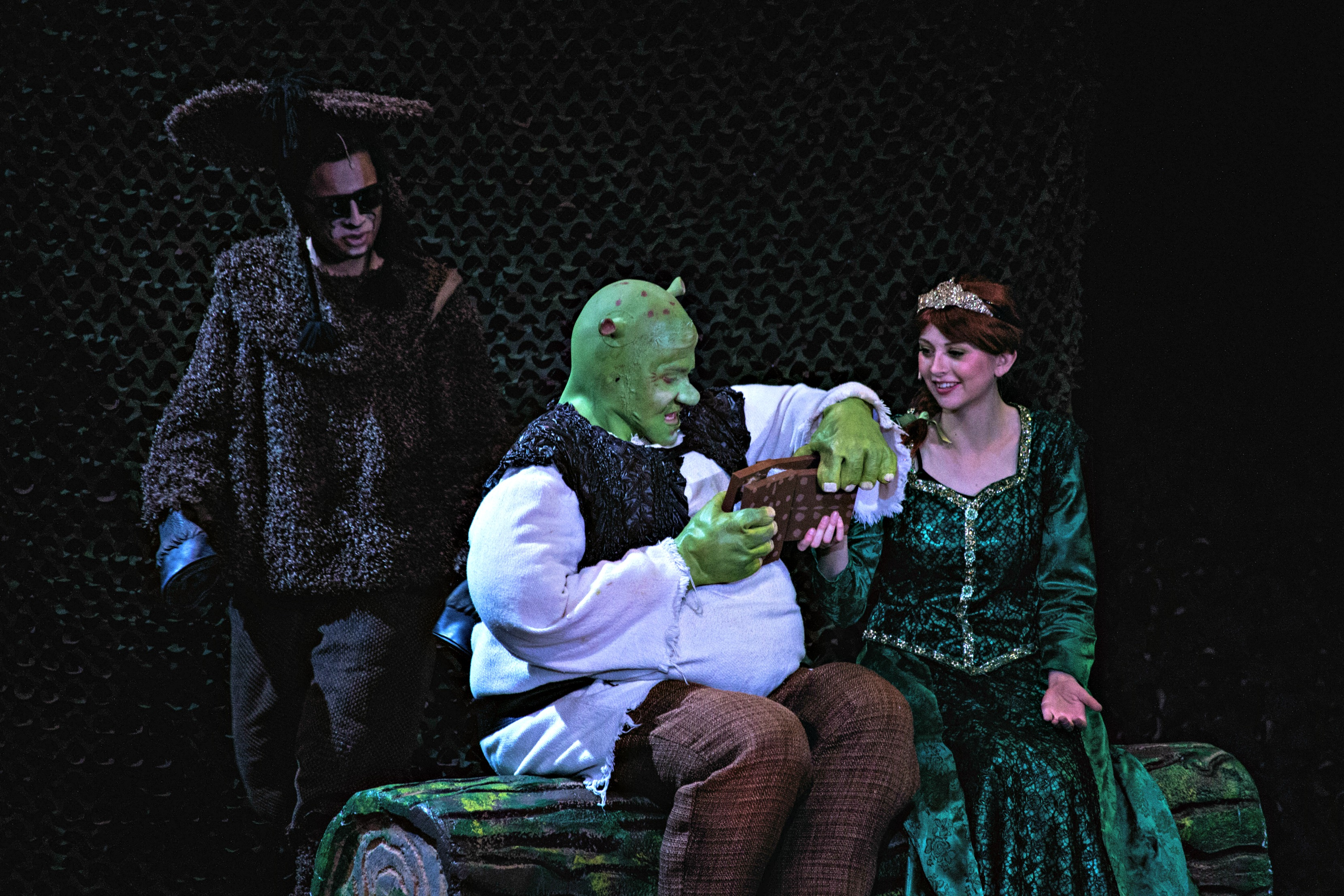 "Michael Mullins performs as Donkey, Daniel Scott as Shrek, and Brooke Meadows as Fiona in the Dixie High School production of ""Shrek The Musical,"" Nov. 4, 2016, St. George, Utah 