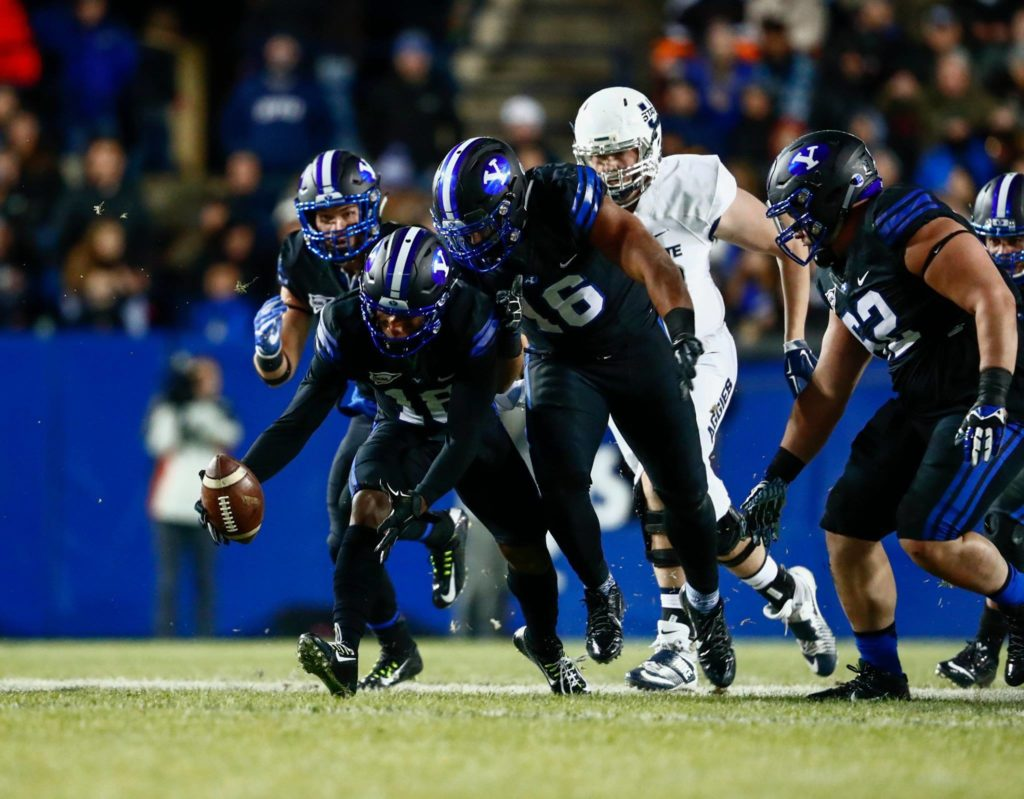 Michael Shelton scoops up a fumble and scores Saturday night, BYU vs. Utah State, Provo, Utah, Nov. 26, 2016 | Photo by BYU Photo