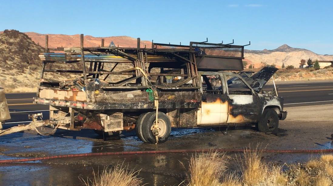 A Chevy pickup truck pulling a small construction trailer is heavily damaged by fire Wednesday morning on state Route 18, St. George, Utah, Nov. 23, 2016 | Photo by Mike Cole, St. George News