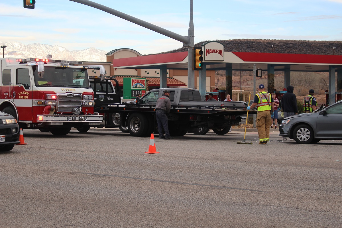 Tow trucks and other emergency vehicles tend to a two-car crash that left a man unconscious after a driver failed to yield while making a left hand turn from S. River Road onto 1450 South Friday, St. George, Utah, Dec. 30, 2016 | Photo by Cody Blowers, St. George News