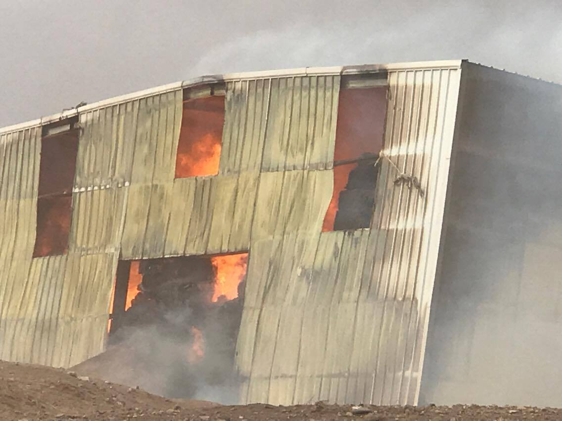 Fire crews responded to a barn fire Friday where $200,000 worth of hay was lost, Iron County, Utah, Dec. 16, 2016 | Photo by Iron County Sheriff Deputy Wade Lee, St. George / Cedar City News