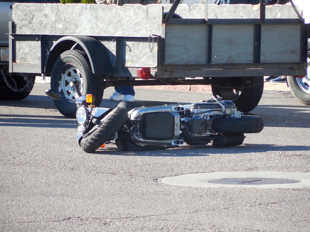 A Honda Ruckus scooter lies on the ground after the second scooter collision within two hours on Main Street, St. George, Utah, Dec. 28, 2016 | Photo by Julie Applegate, St. George News