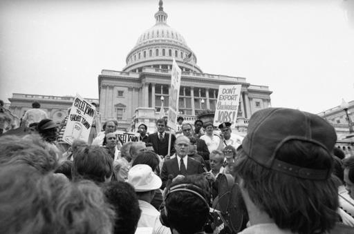 FILE - In this Friday, Sept. 23, 1977 file photo, Sen. John Glenn, D-Ohio, center, speaks to a group of Youngstown, Ohio Steelworkers on the steps of the Capitol in Washington. The group urged the government to curb steel imports and to relax pollution control requirements. Glenn, the first U.S. astronaut to orbit Earth who later spent 24 years representing Ohio in the Senate, died Thursday, Dec. 8, 2016, at the age of 95. (AP Photo/Harvey Georges, File)