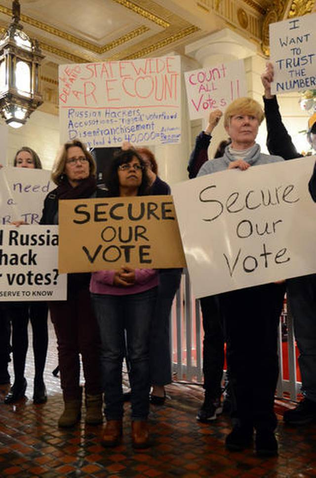 In this Dec. 5, 2016, AP photo, participants listen to a speaker at a rally at the Pennsylvania Capitol in support of a Green Party-backed quest for a recount of Pennsylvania's Nov. 8 presidential election. Harrisburg, Pennsylvania, Dec. 5, 2016   AP Photo/Marc Levy, St. George News