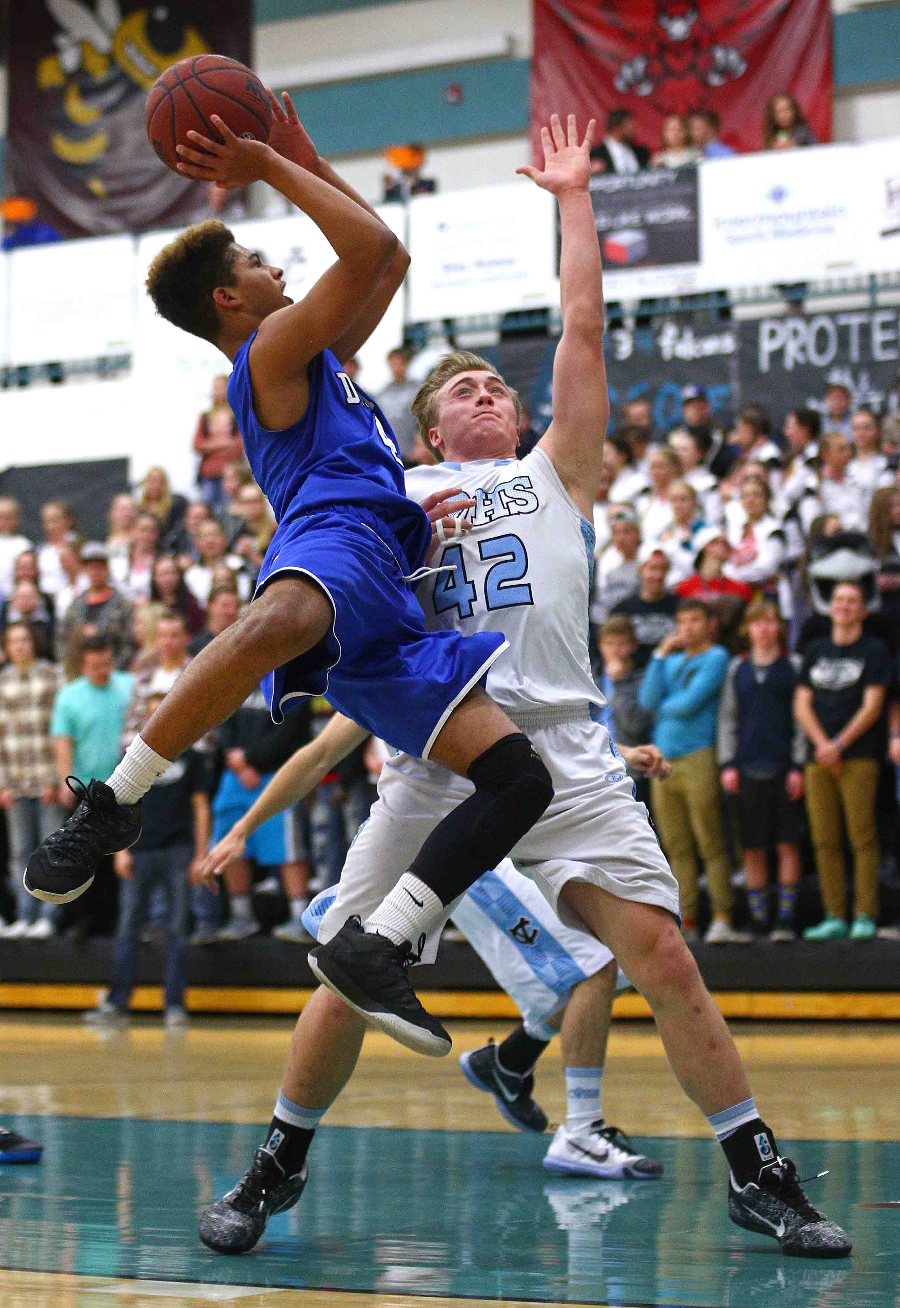 Dixie's Kaden Elzy (4), Canyon View vs. Dixie, Boys Basketball, Cedar City, Utah, Dec. 6, 2016, | Photo by Robert Hoppie, ASPpix.com, St. George News