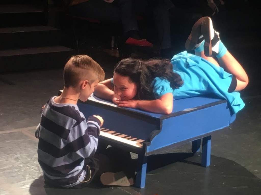 """L-R: McKay Cox as Schroeder and Brooklyn Larson as Lucy perform a musical scene from St. George Musical Theater's production of """"A Charlie Brown Christmas,"""" St. George, Utah, Dec. 3, 2016   Photo by Hollie Reina, St. George News"""