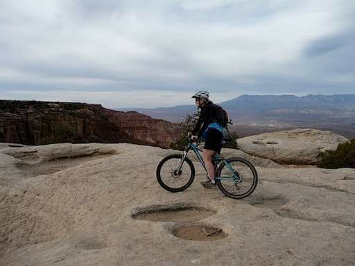 Wendy West stops to enjoy the view on the Gooseberry Mesa Trail near Apple Valley, Utah, Nov. 25, 2016 | Photo courtesy of Cassy Jones, St. George News