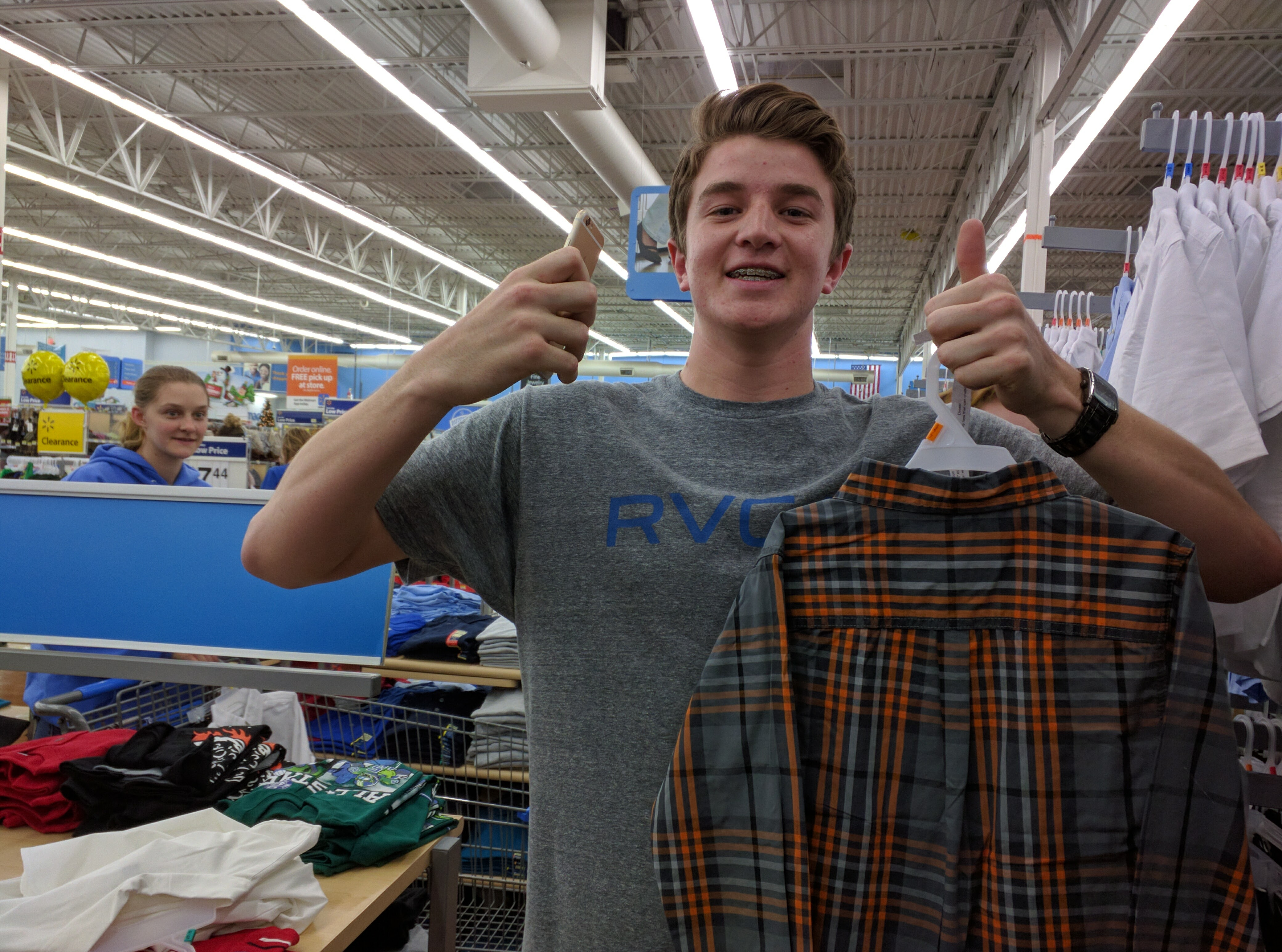 Dixie High School student Tanner Hansen shops for the school's Angel Tree project, St. George, Utah, Dec. 12, 2016 | Photo by Joseph Witham, St. George News