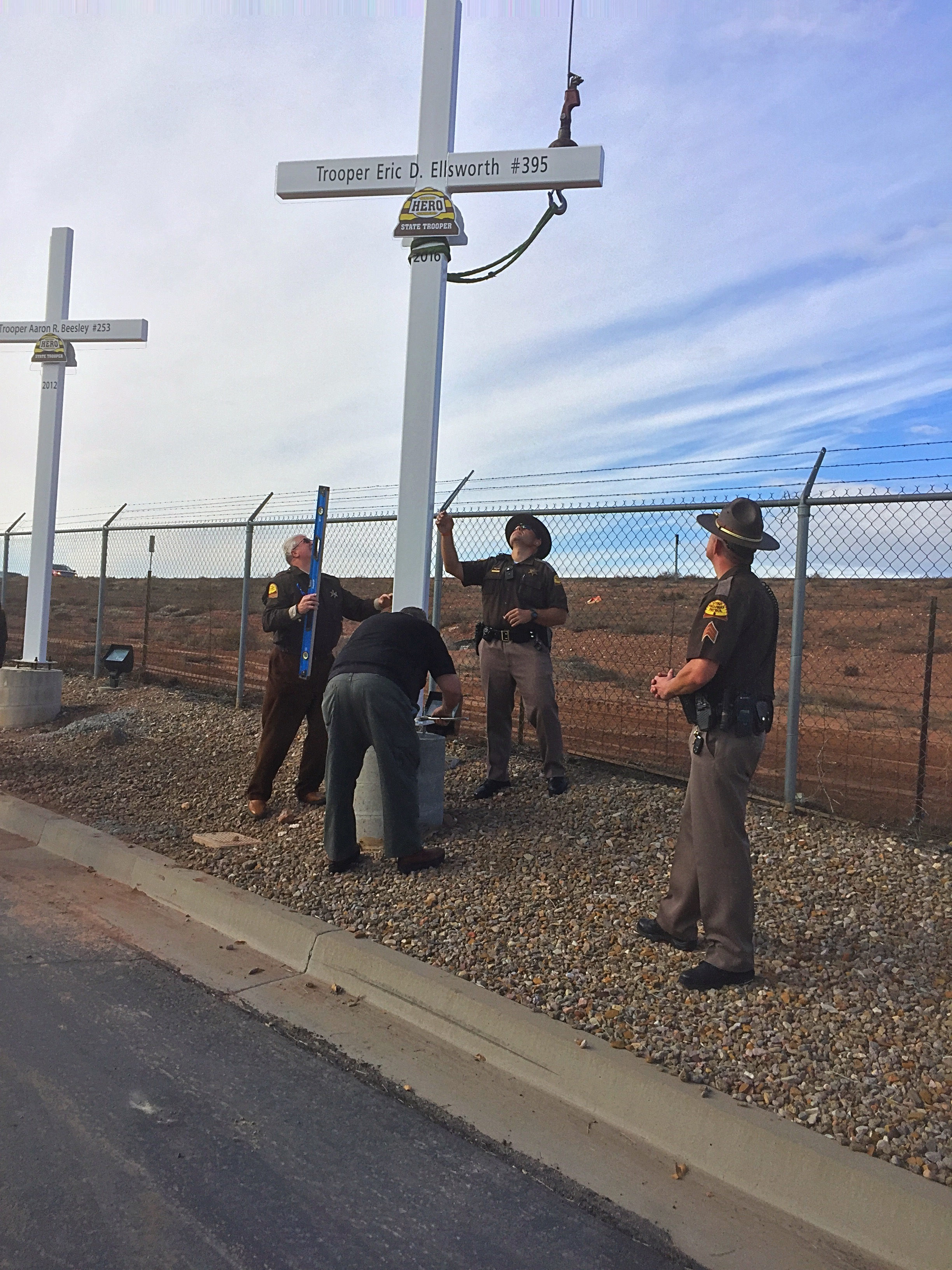A memorial cross was erected along Interstate 15 in honor of Utah Highway Patrol Trooper Eric Ellsworth who died last month after being struck by a vehicle, DATS Trucking, 321 N. Old Highway 91, Hurricane, Utah, Dec. 30, 2016 | Photo by Kimberly Scott, St. George News