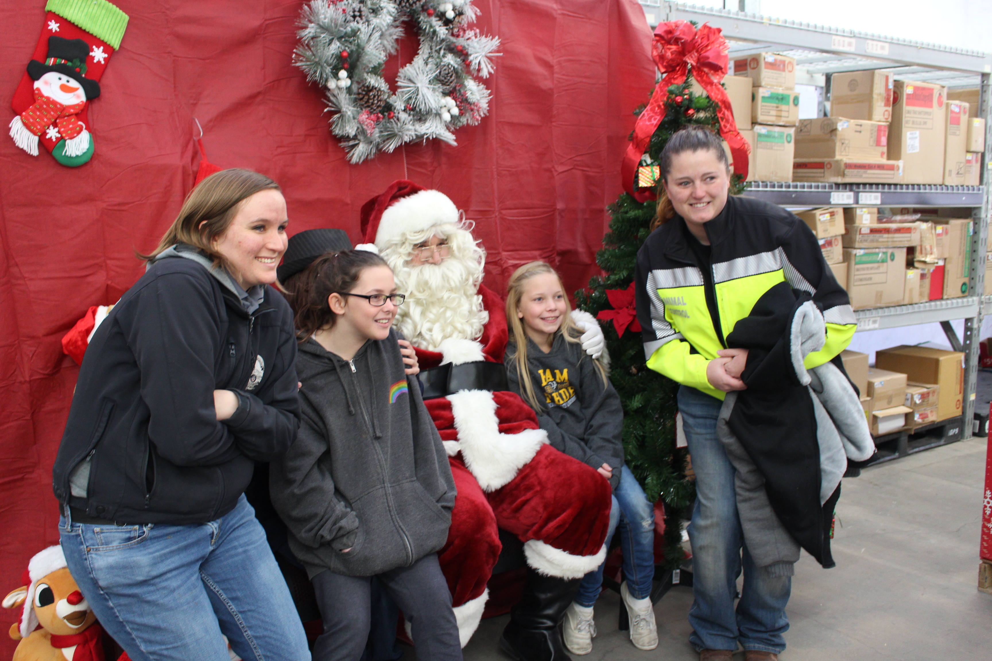 Santa Claus poses for photos with the kids during the Shop with a Cop event Saturday. St. George, Utah, Dec. 10, 2016 | Photo by Tracie Sullivan, St. George / Cedar City News