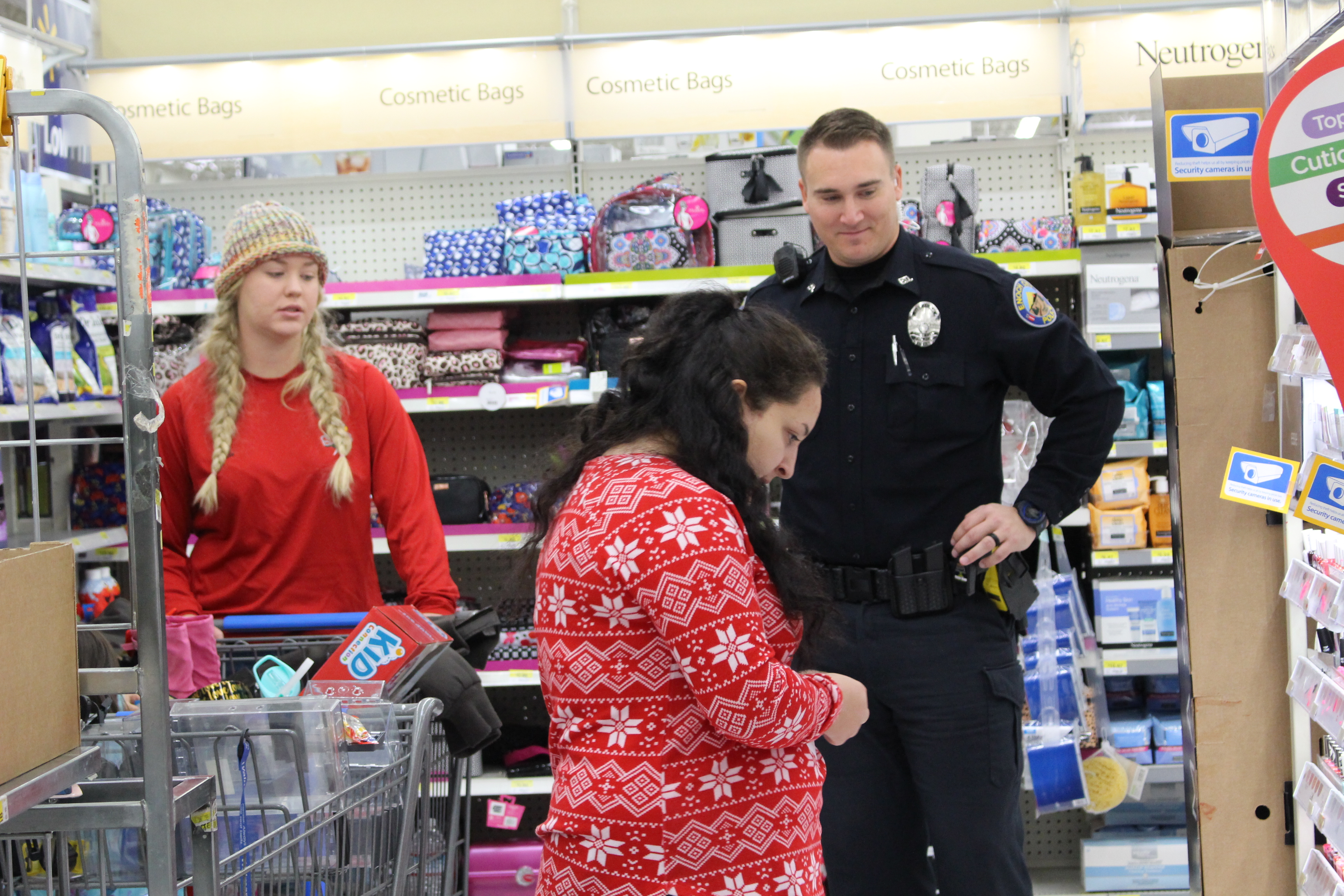 Cedar City Officers have fun watching the kids pick out their gifts during the Shop with a Cop event Saturday. St. George, Utah, Dec. 10, 2016 | Photo by Tracie Sullivan, St. George / Cedar City News