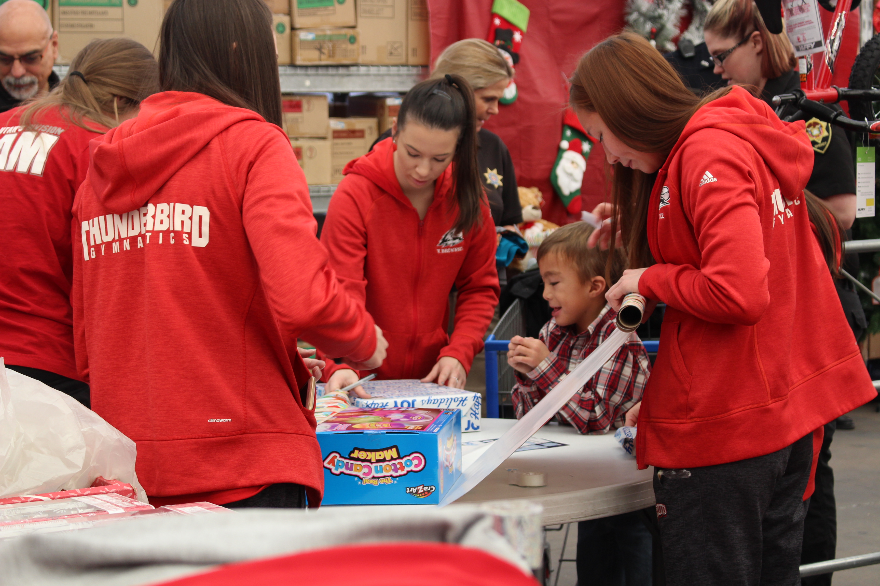 SUU Thunderbirds help wrap gifts Saturday at the Shop with a Cop event. St. George, Utah, Dec. 10, 2016 | Photo by Tracie Sullivan, St. George / Cedar City News