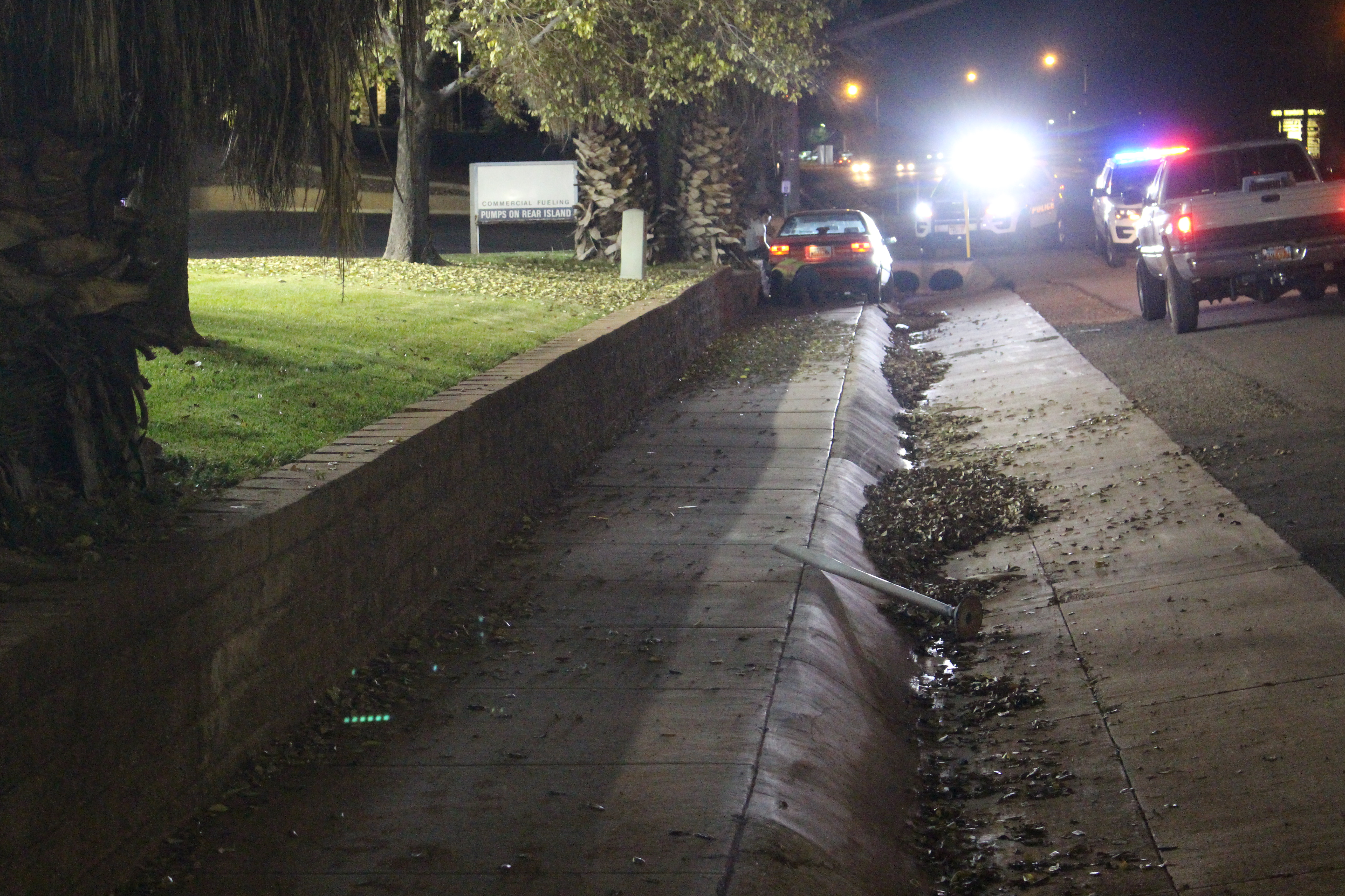 A car sits stuck in a ditch after a mechanical failure caused its driver to drive off the road, St. George, Utah, Dec. 11, 2016   Photo by Joseph Witham, St. George News