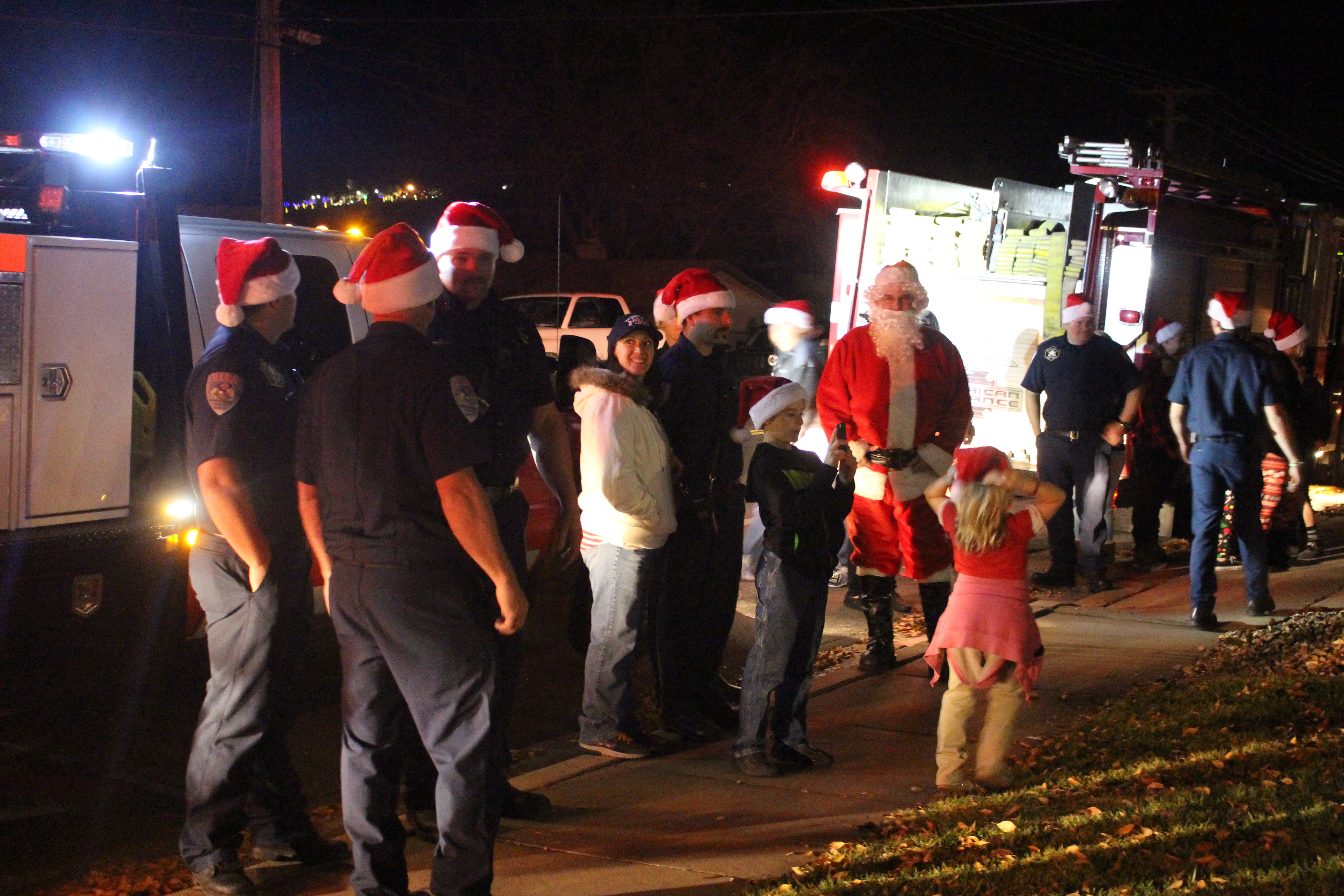 Washington City Fire personnel and their families deliver gifts to a family in need for the Angel Tree Project, Washington, Utah, Dec. 22, 2016   Photo by Joseph Witham, St. George News