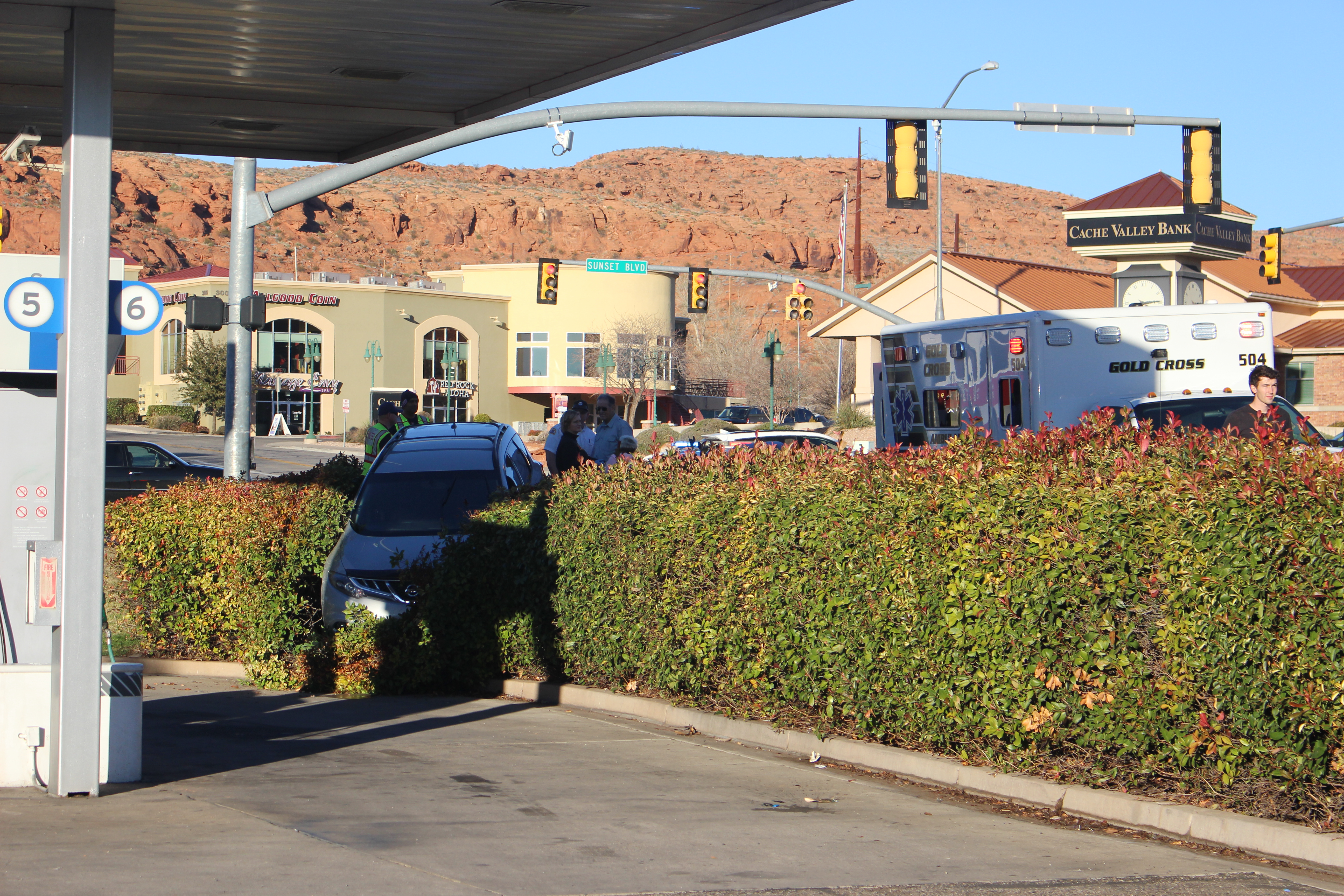 A car rests in the bushes of a gas station after its driver reportedly suffered a medical condition and drove it off the road, St. George, Utah, Dec. 29, 2016 | Photo by Joseph Witham, St. George News