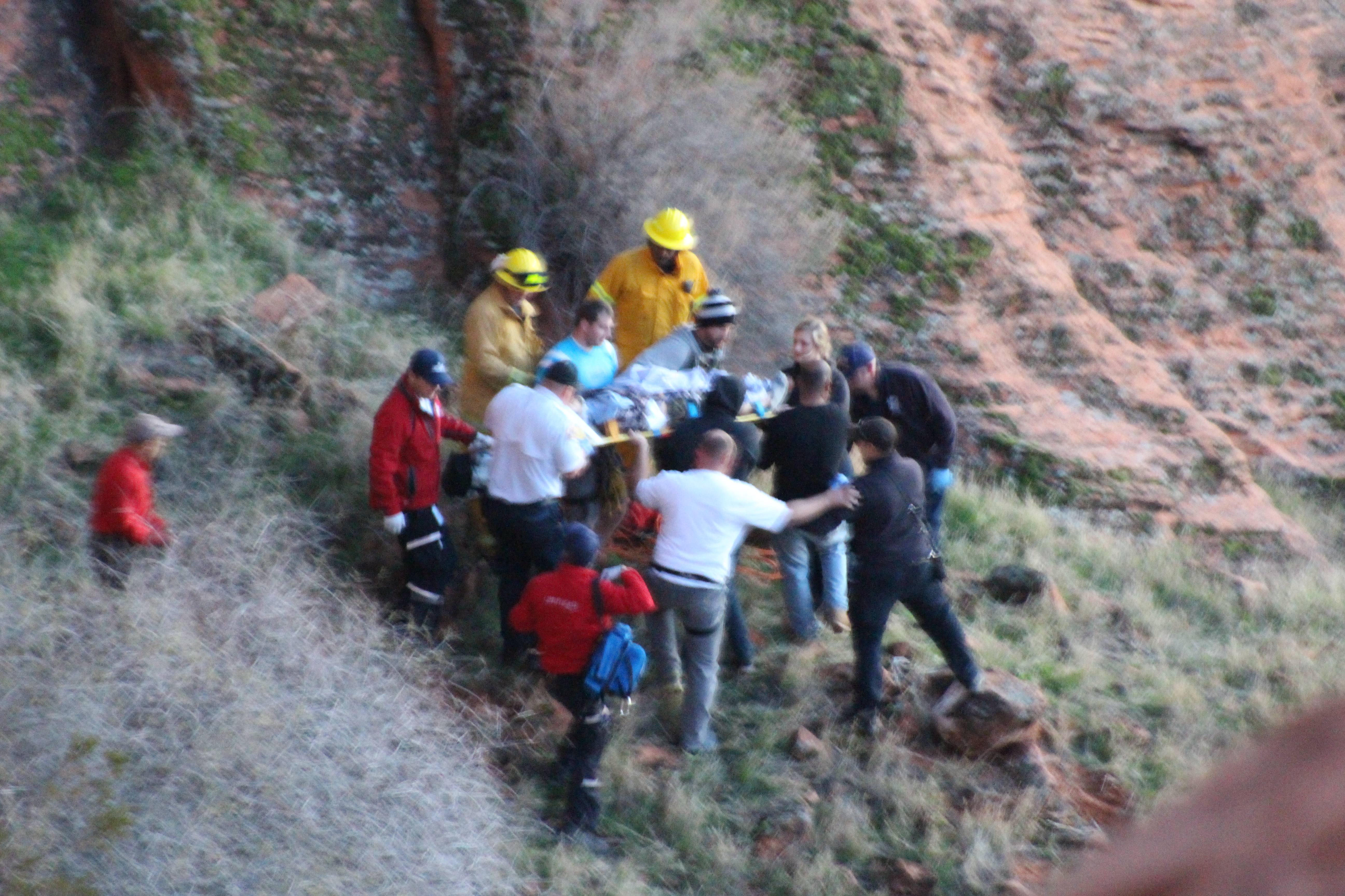 Rescuers transport a man who had fallen during a rappel to a Life Flight helicopter, Cougar Cliffs Climbing Area, St. George, Utah, Dec. 29, 2016 | Photo by Joseph Witham, St. George News