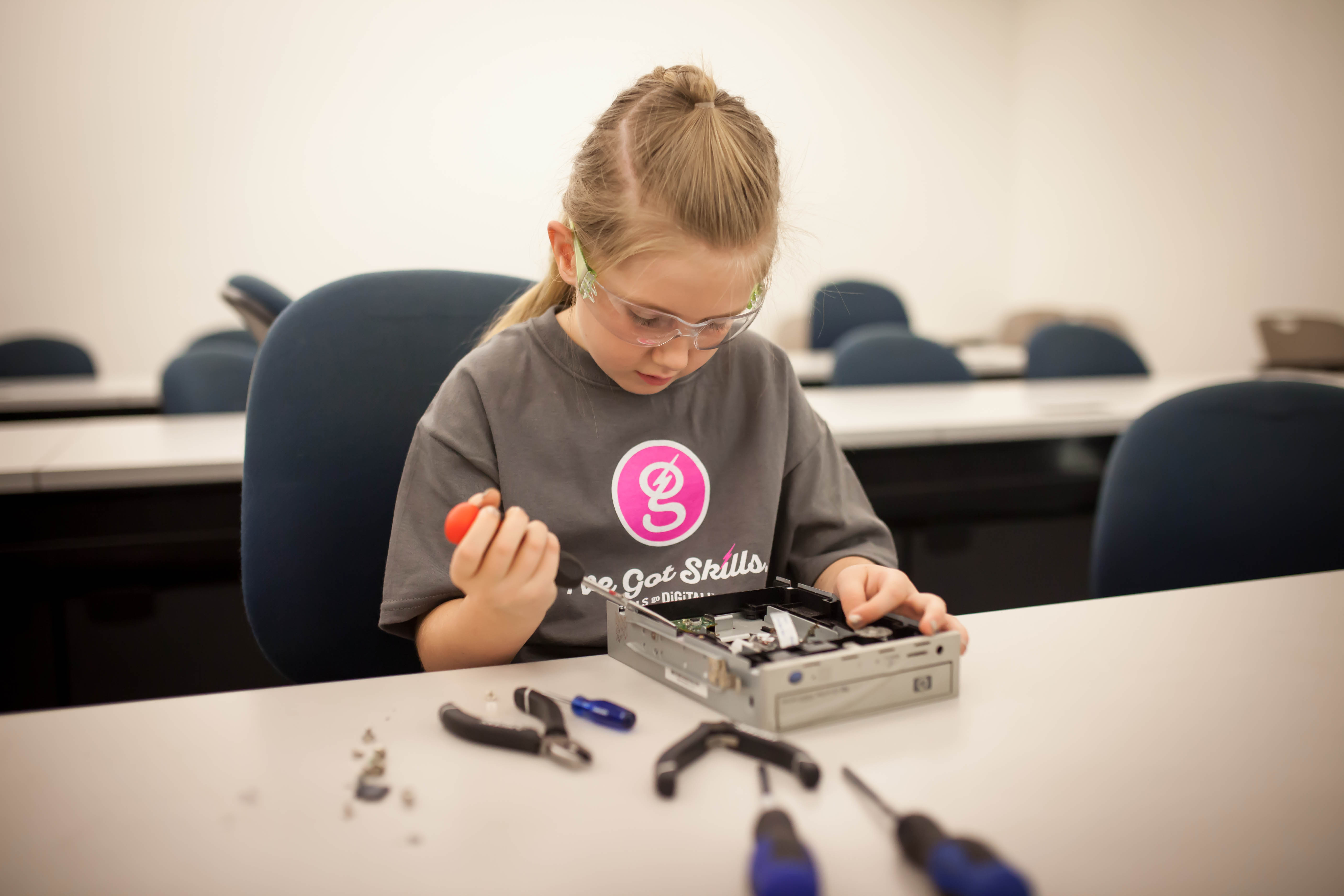 A girl works on an optical drive at a Girls go Digital camp, date and location not specified | Photo courtesy of Girls go Digital, St. George News