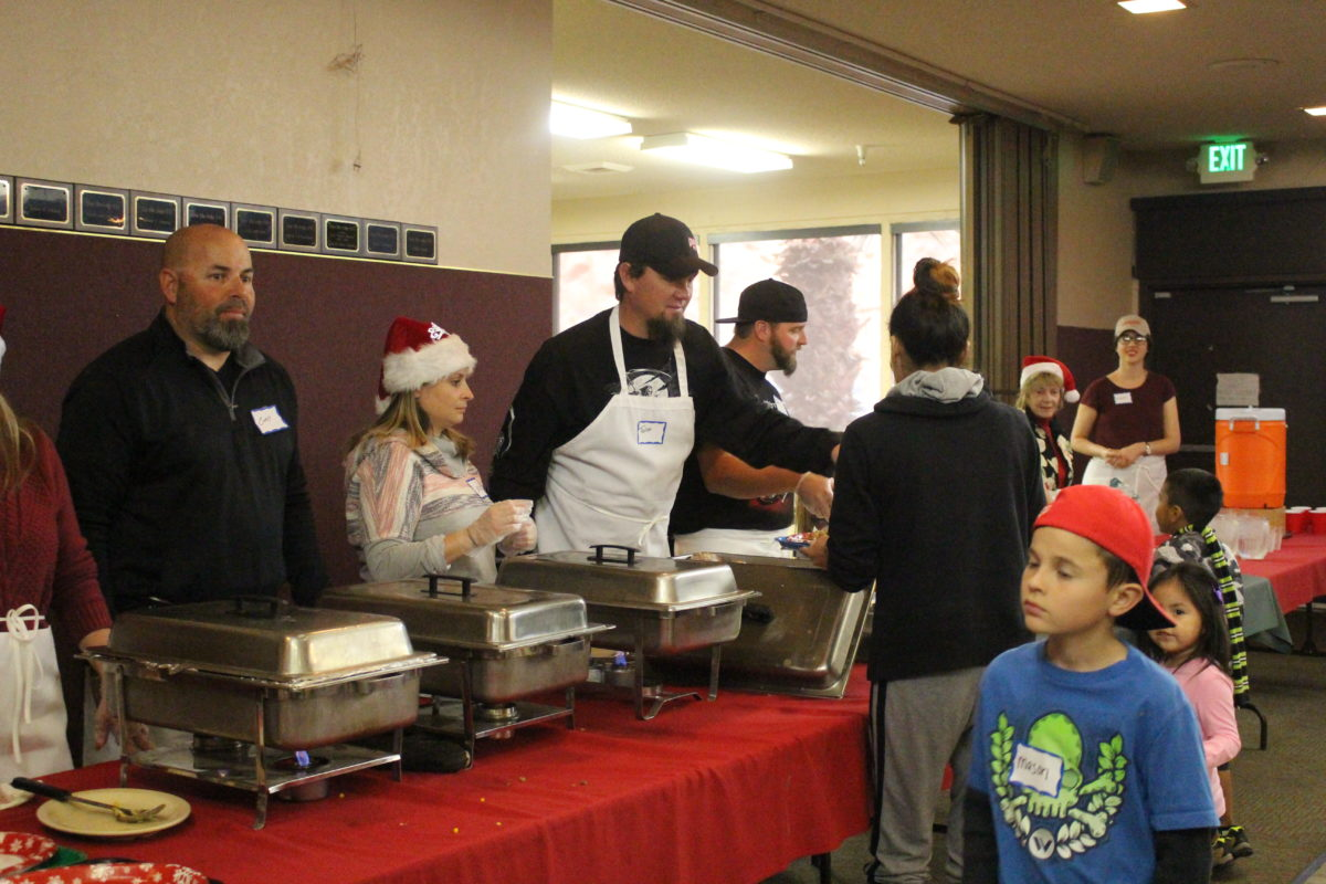 Volunteers from Bikers Against Child Abuse serving all the fixings for a holidaay dinner, including turkey, stuffing, mash potatoes, ham and other fixings at the Elks Lodge in St. George, Utah, Dec. 25, 2016 | Photo by Cody BLowers, St. George News