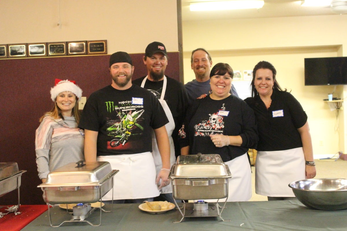 Bikers Against Child Abuse members spend time on Christmas day serving a holiday meal to those in need. Dixie Elks Lodge, St. George, Utah, Dec. 25, 2016 | Photo by Cody Blowers, St. George News