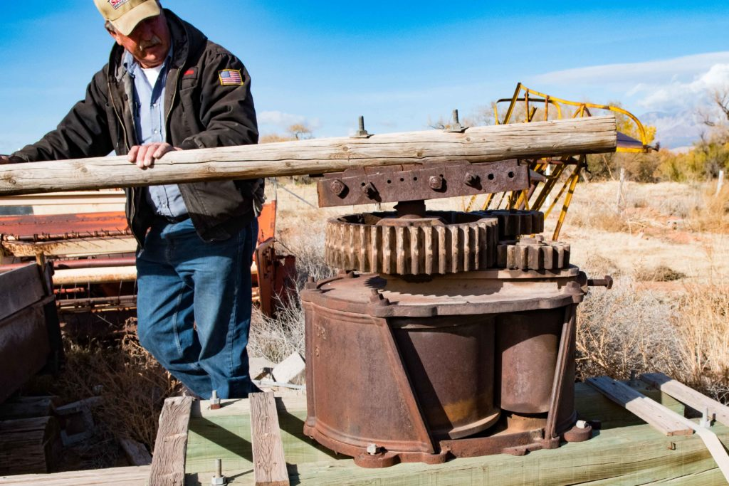 John Kirkland demonstrates an older sorghum squeezing mill that was operated by a team of horses, Washington, Utah, Dec. 12, 2016 | Photo by and courtesy of Jim Lillywhite, St. George News
