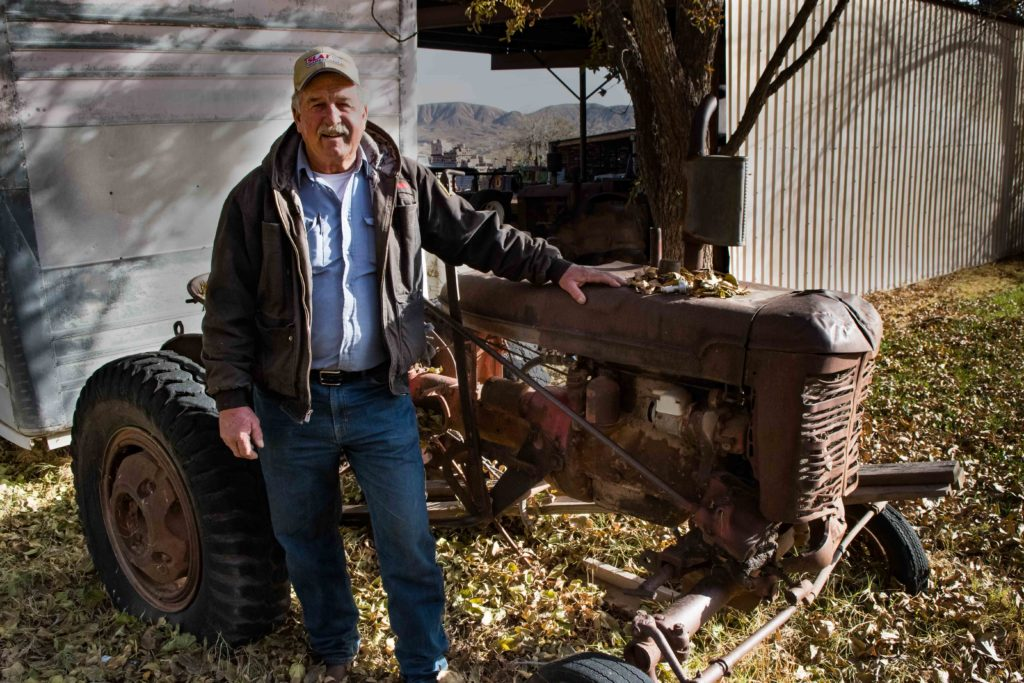 John Kirkland stands next to his first tractor, Washinton, Utah, Dec. 12, 2016 | Photo by and courtesy of Jim Lillywhite, St. George News